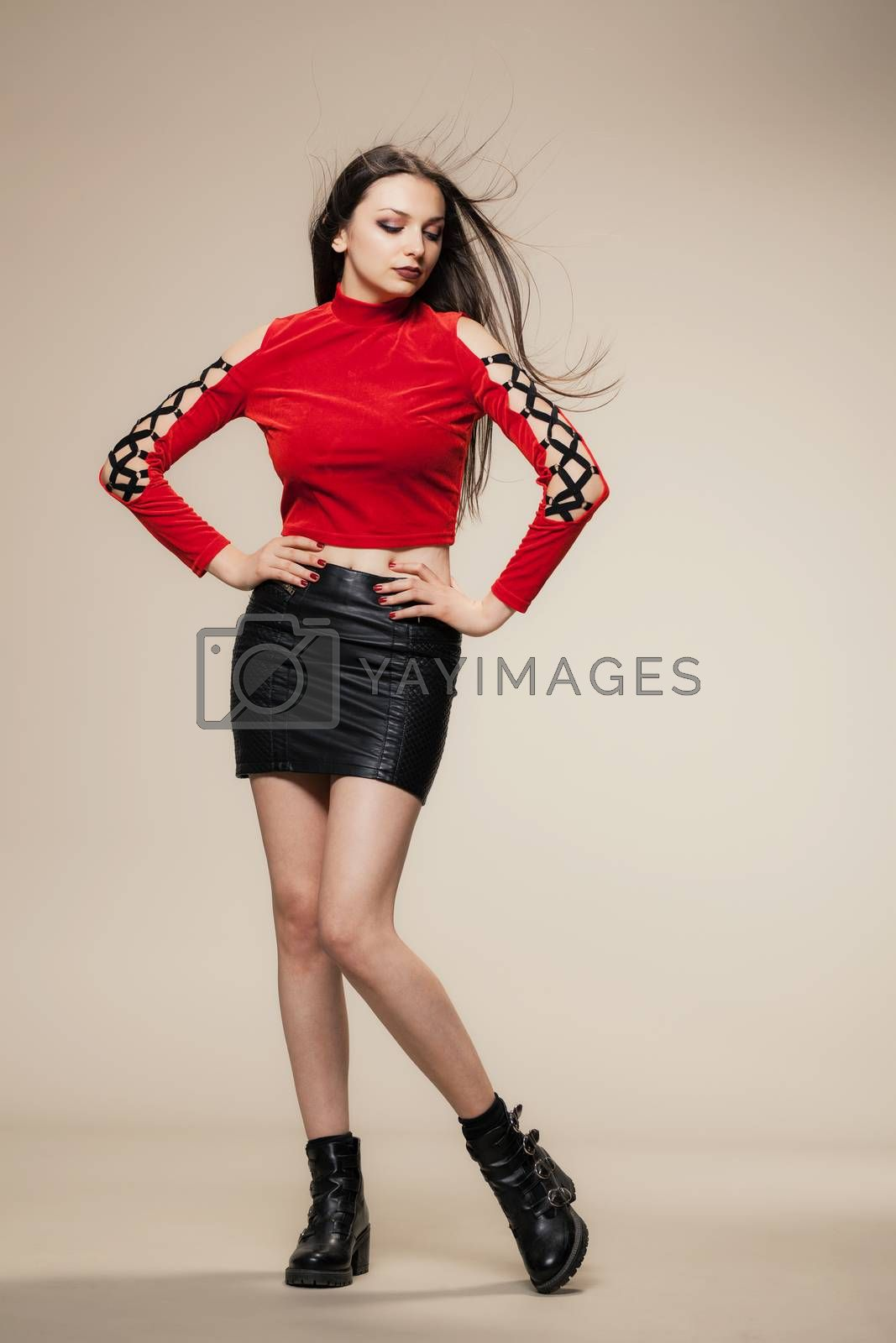 gothic style girl in red shirt, short black dress and boots