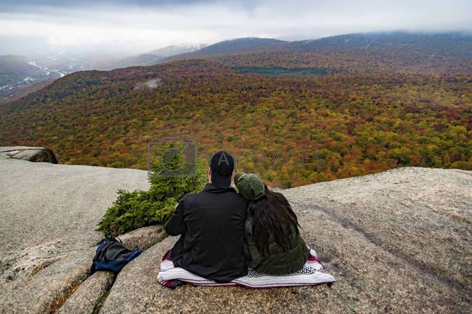 Two hikers watching fall foliage around Mount Washington in New Hampshire, USA