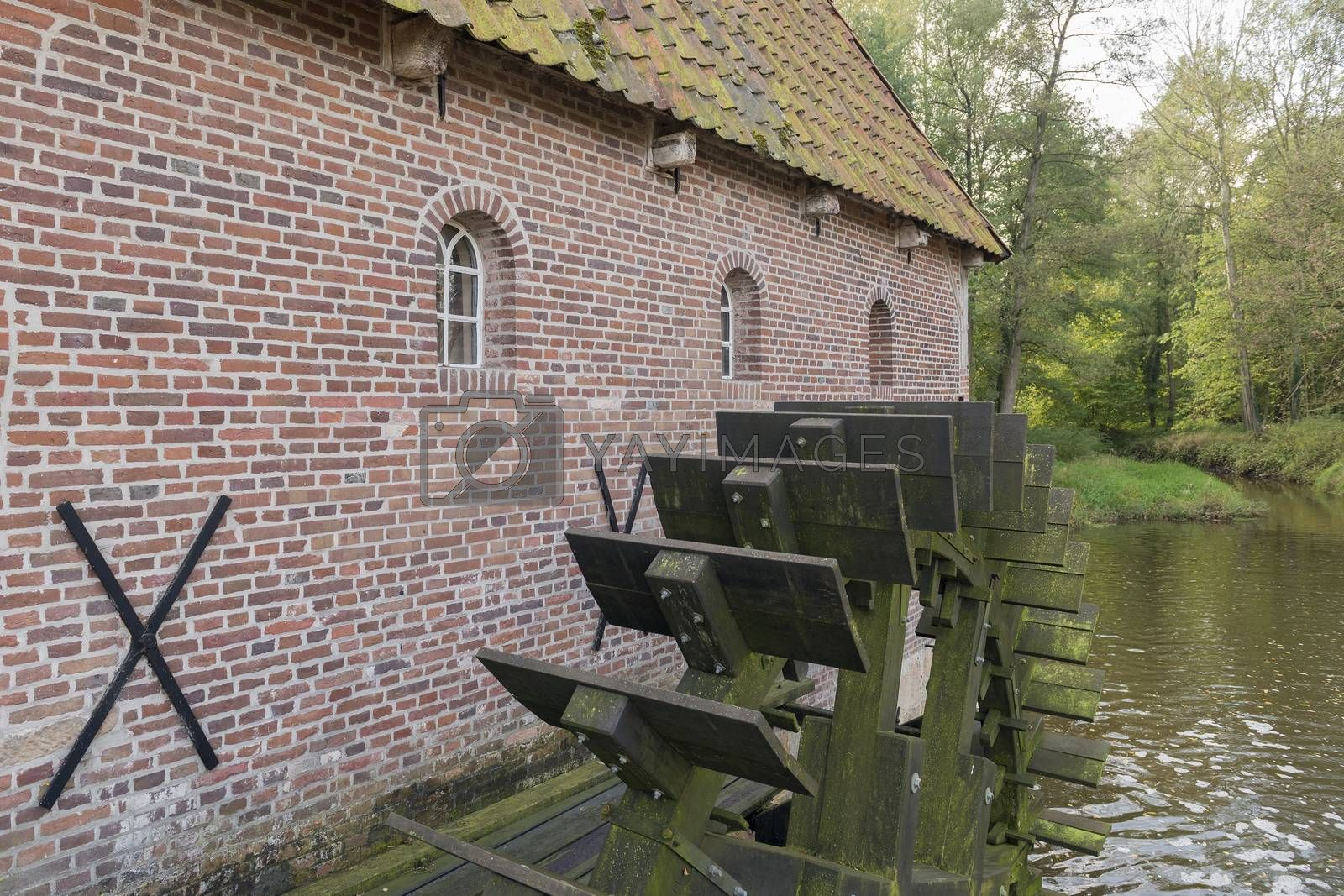 The restored historic water mill called Berenschot in the stream of the river the Boven-Slinge in Winterswijk in Hamlet the Achterhoek in the Netherlands.