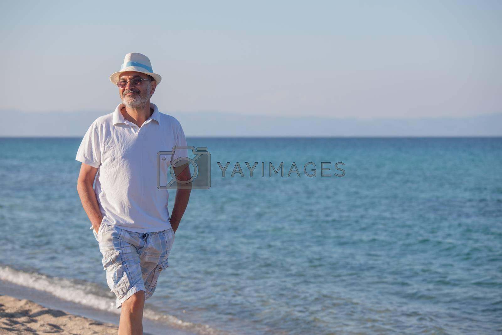 Royalty free image of Elderly Man Seashore Beach Sea by vilevi