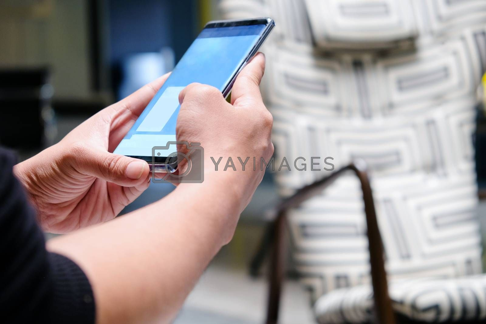 communication technology,close up of hand typing on phone