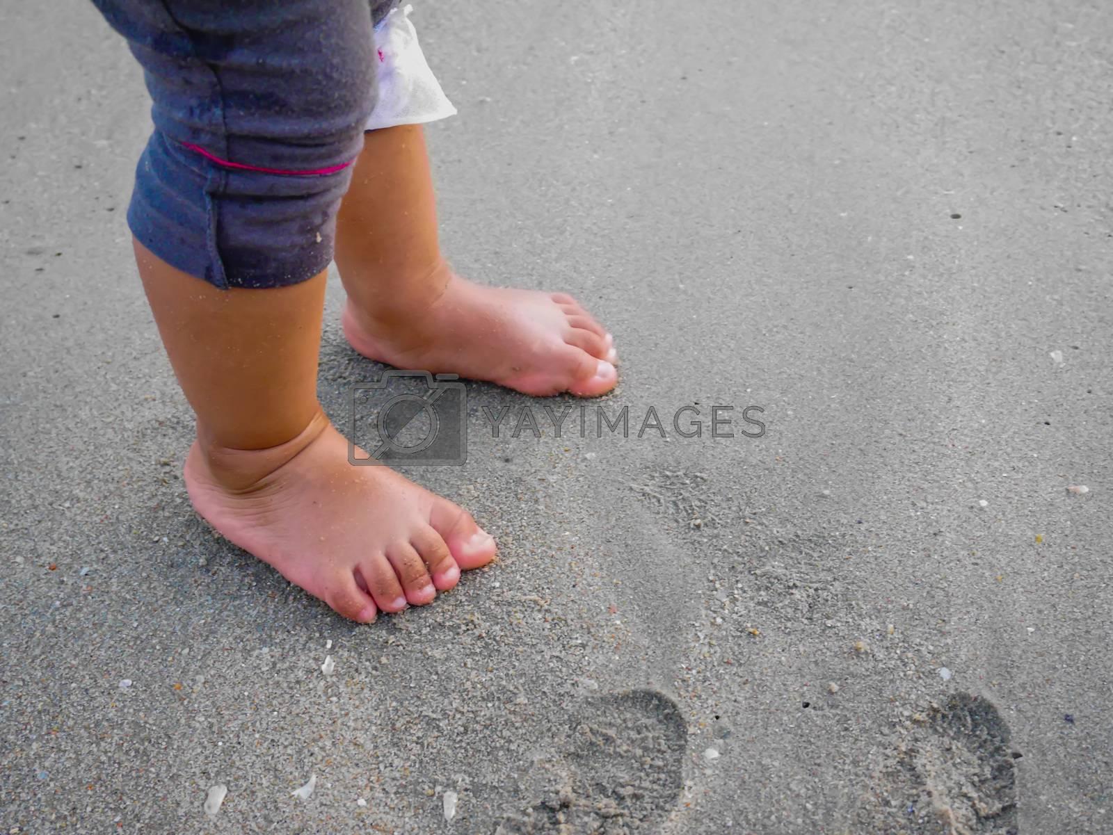 Toddler on beach by korawig