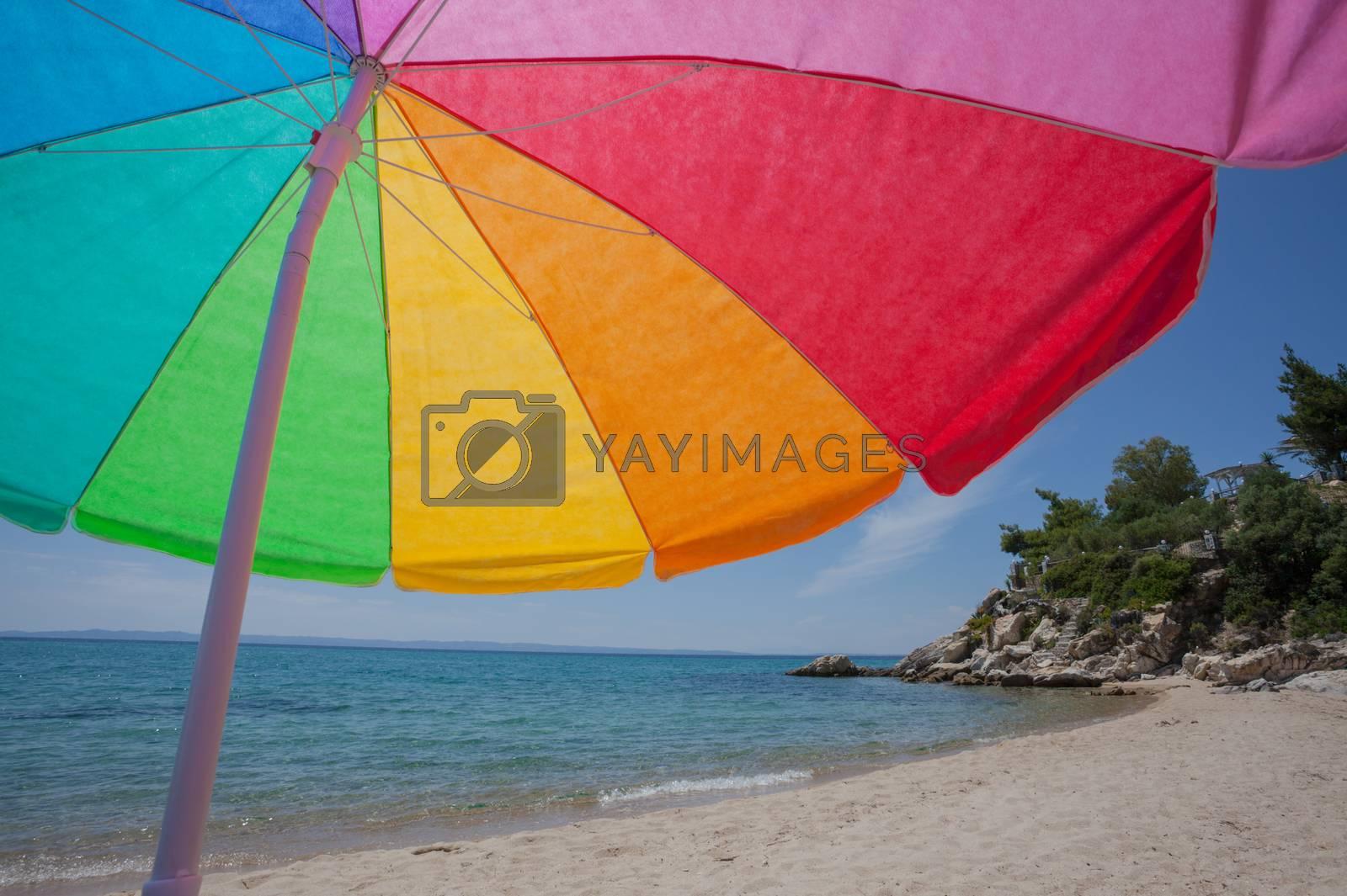 Royalty free image of Colorful Umbrella Beach Sea by vilevi