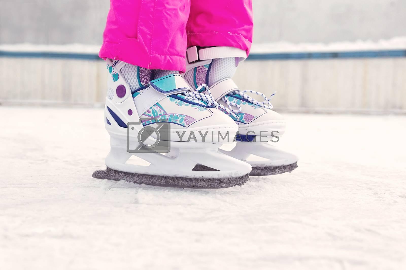 Figure skating. Children white skating on ice. Children's winter sports. Outdoor activities in winter.