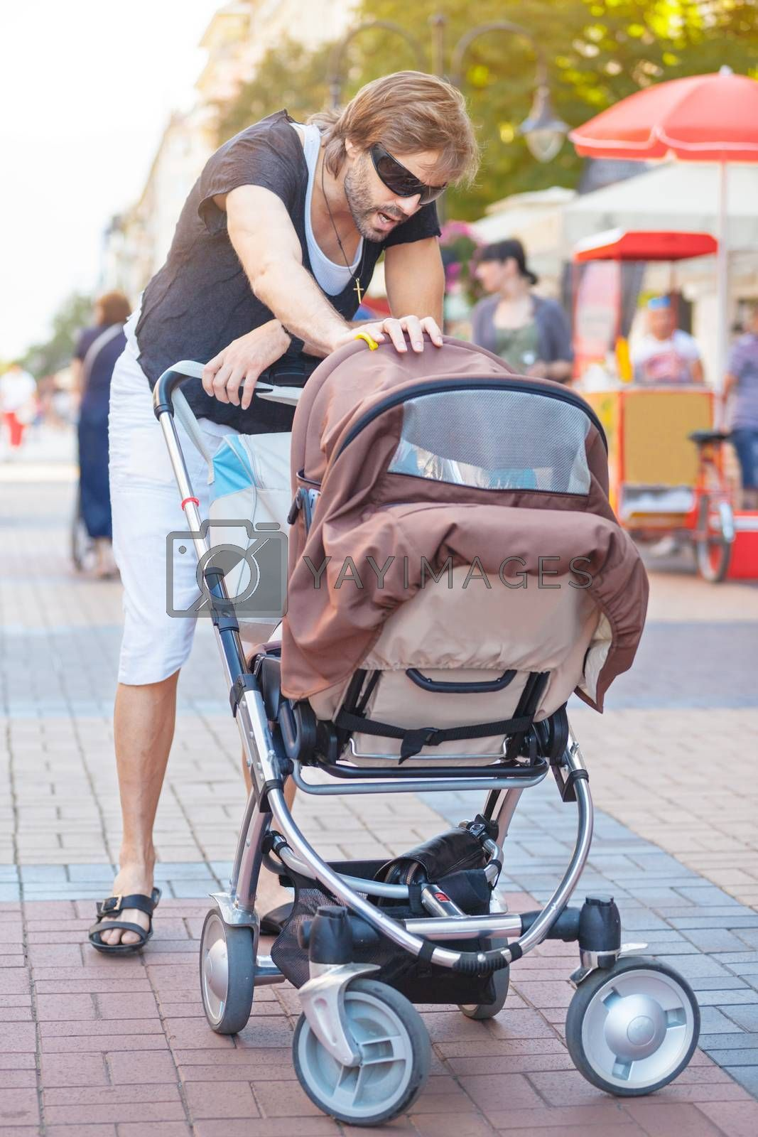 Royalty free image of Young Father Stroller by vilevi