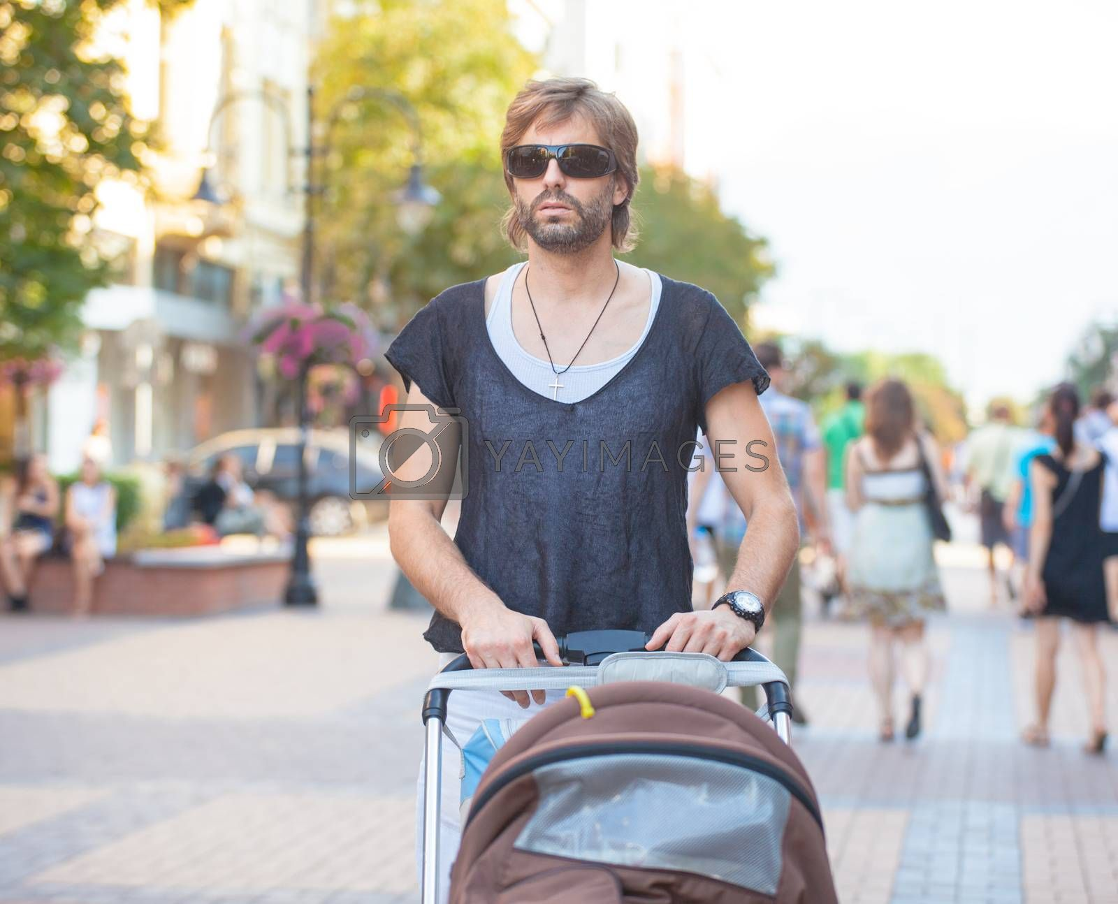 Royalty free image of Young Father Outdoors by vilevi