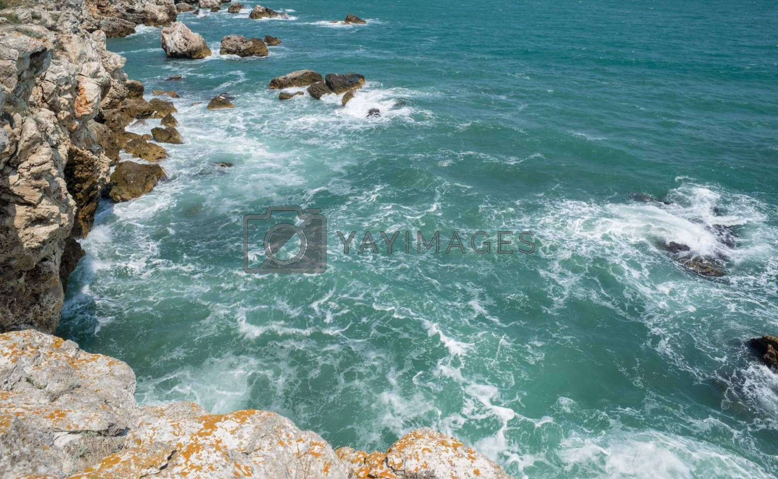 Waves pounding a beautiful rock shore of sea or ocean, Tyulenovo, Bulgaria.