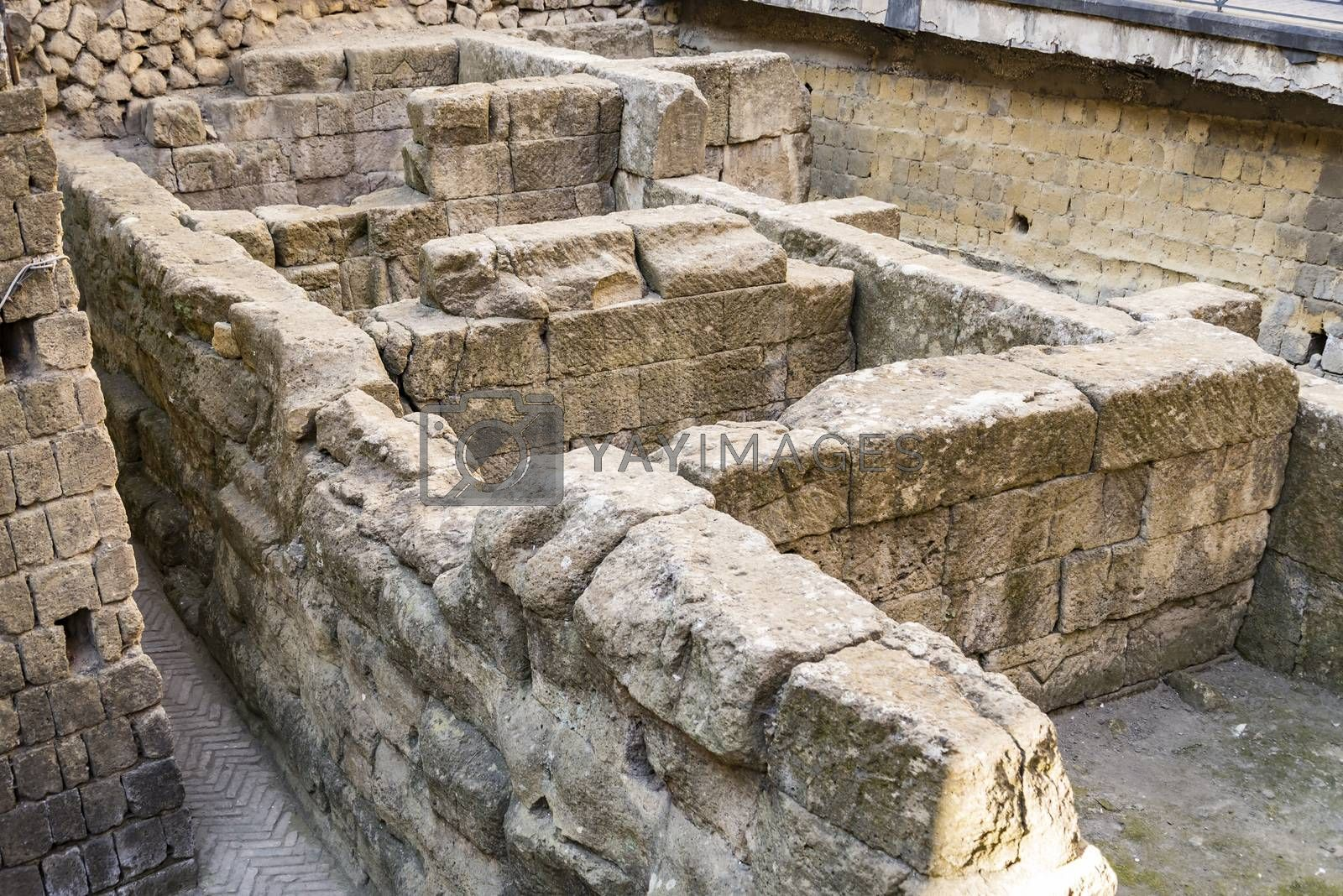 Ruins of the greek walls in Piazza bellini, Naples, Italy