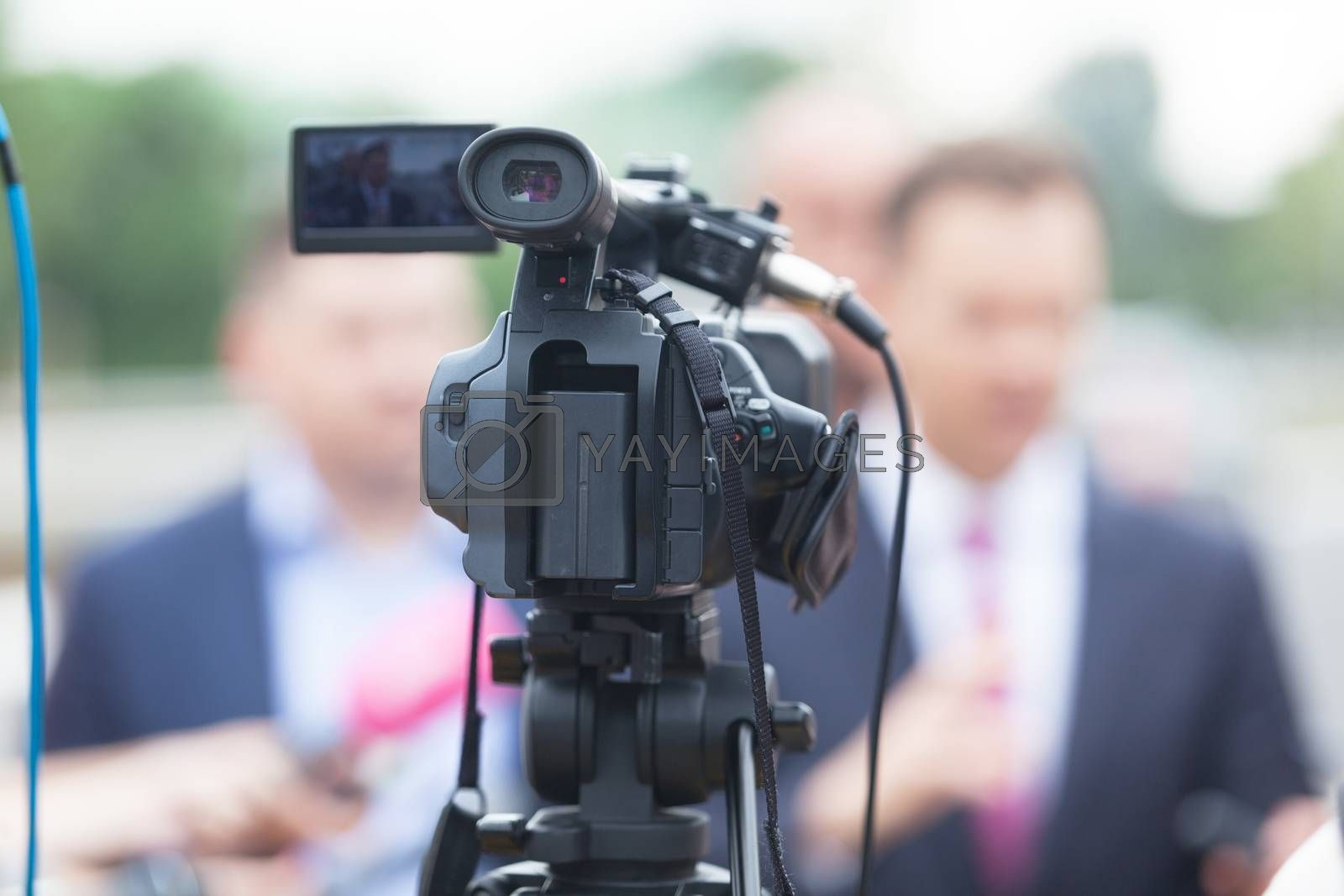 Video or television camera. News conference. TV broadcasting.