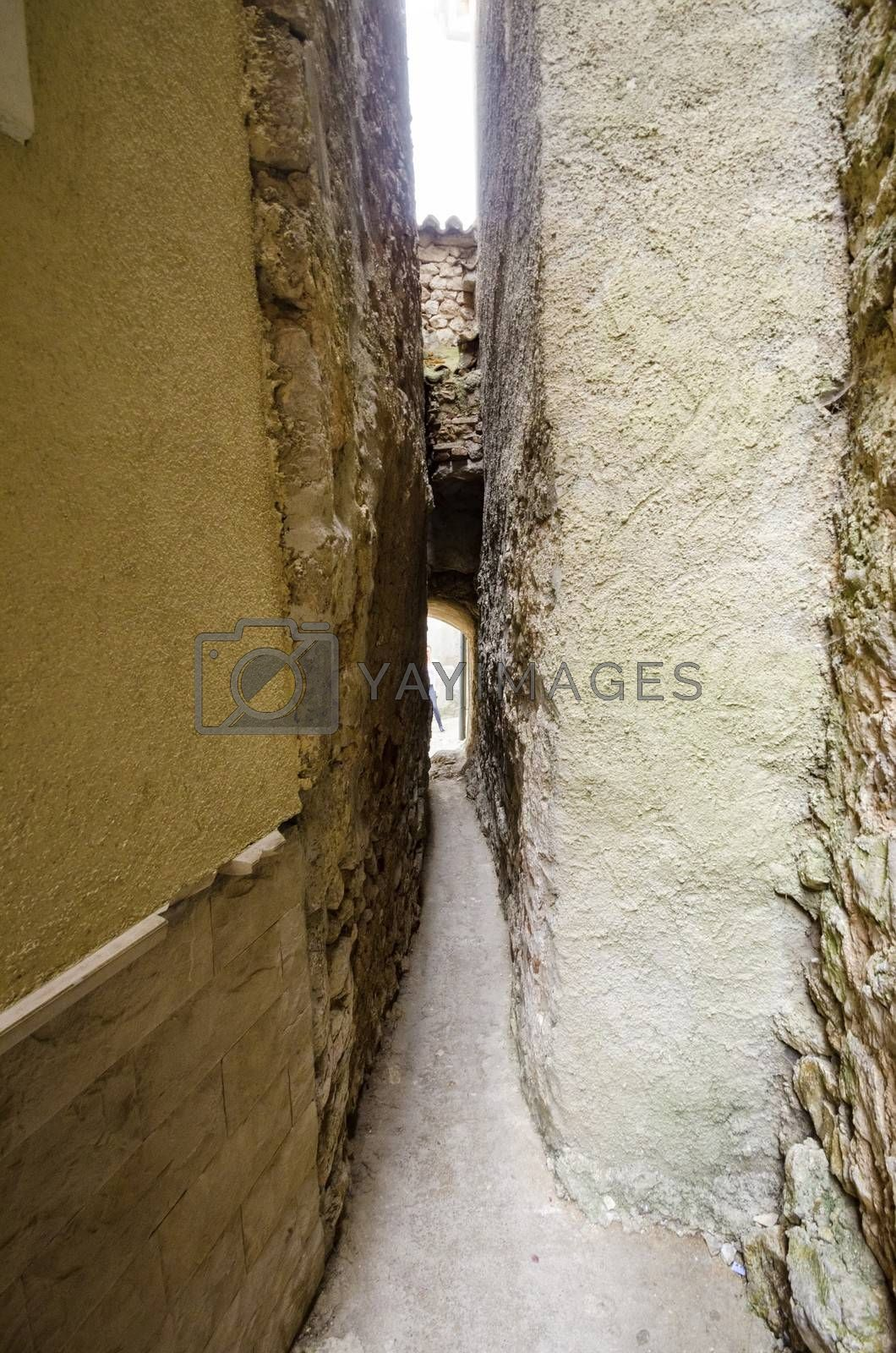 Klancic the narrowest street in the world in Vrbnik town, Krk island, Croatia. Only 43cm wide, stone, medieval, traditional Mediterranean architecture alley in the historic town.