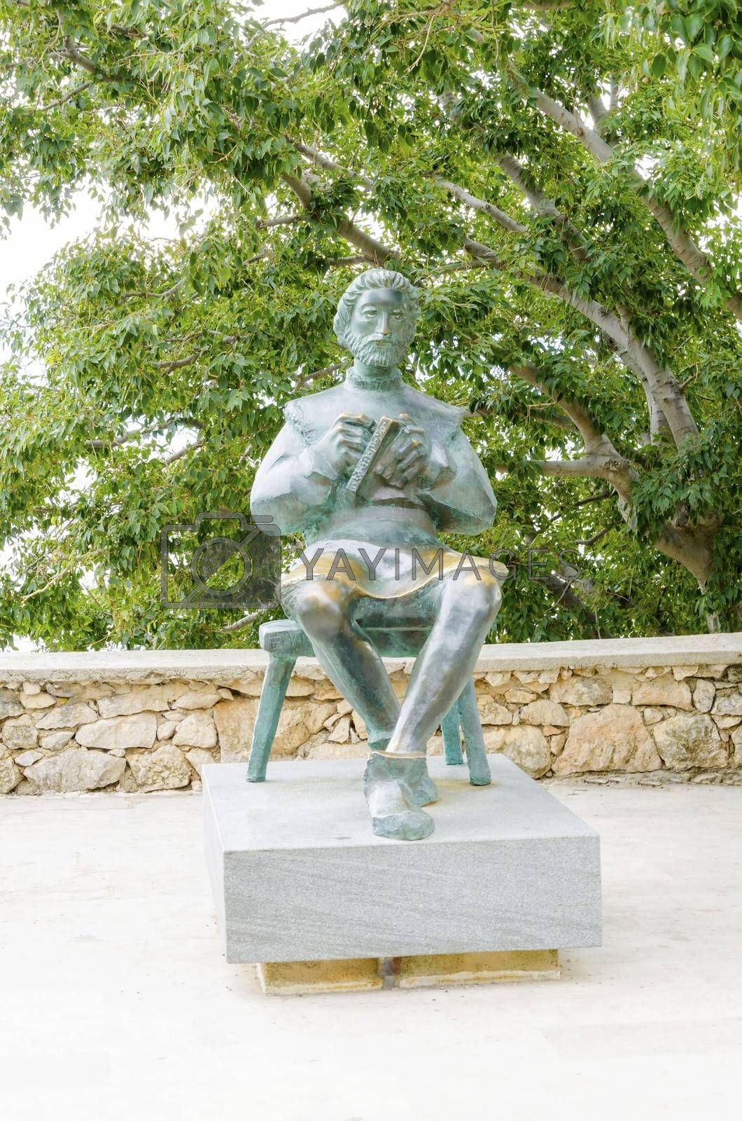 Bronze statue of Blaz Baromic holding a book in Vrbnik town, Krk, Croatia. One of the first printer, calligraphers who founded senj using the glagolitic alphabet in print.