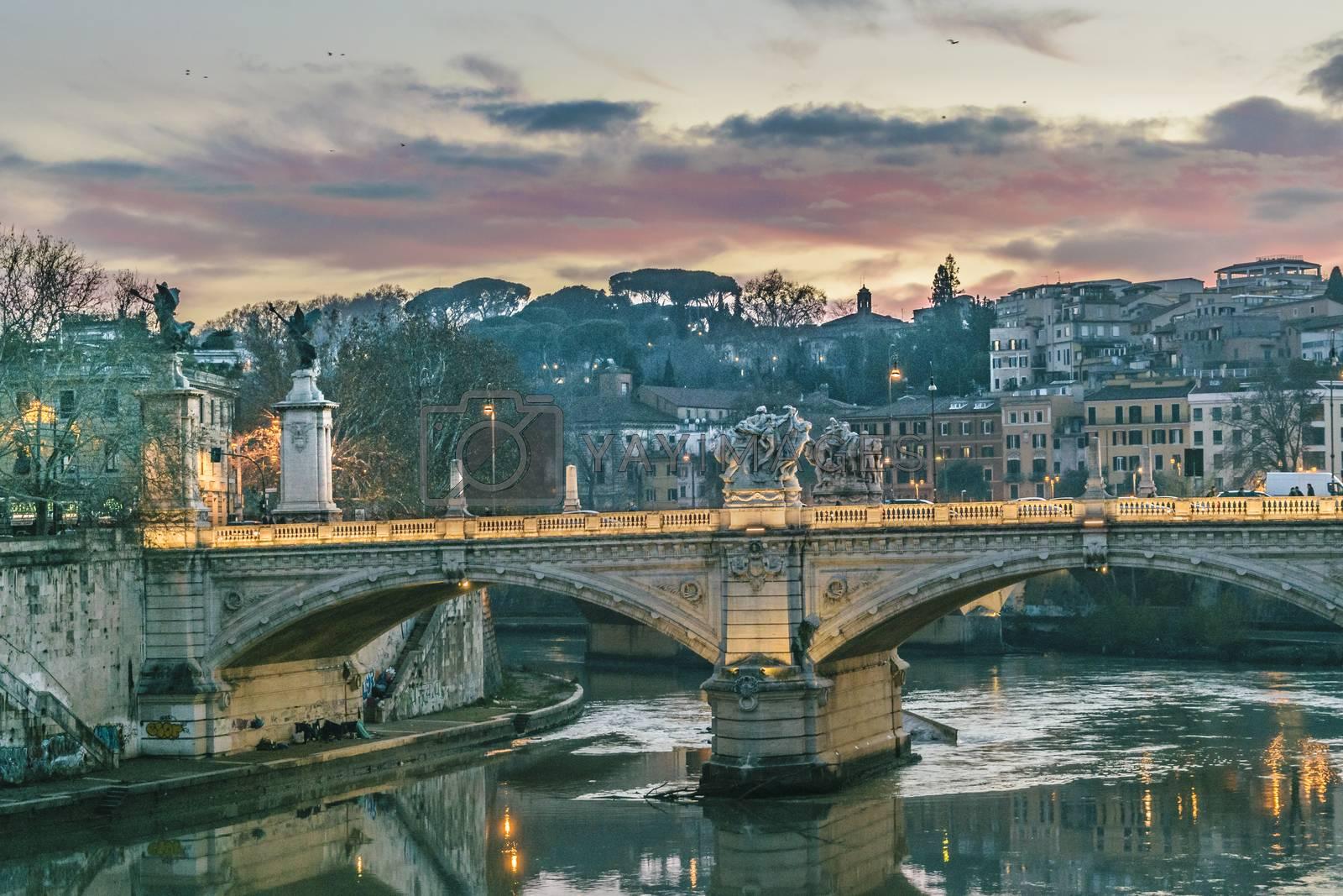 Urban cityscape twilight winter season scene at tiber river in Rome city, Italy