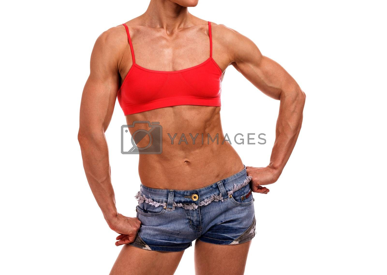 Strong fitness woman posing on a white background, isolated