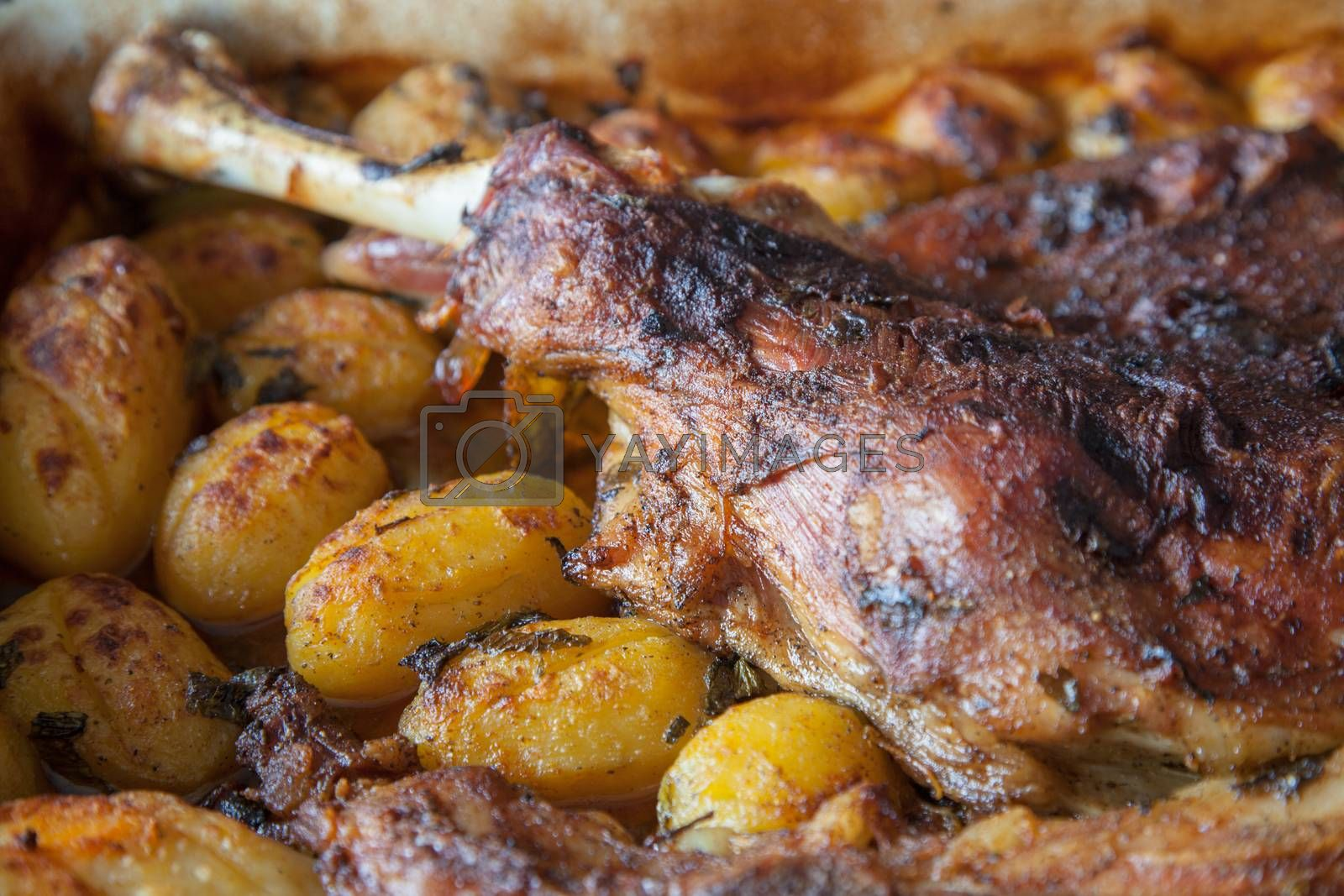 Delicious lamb shoulder, roasted with whole potatoes.