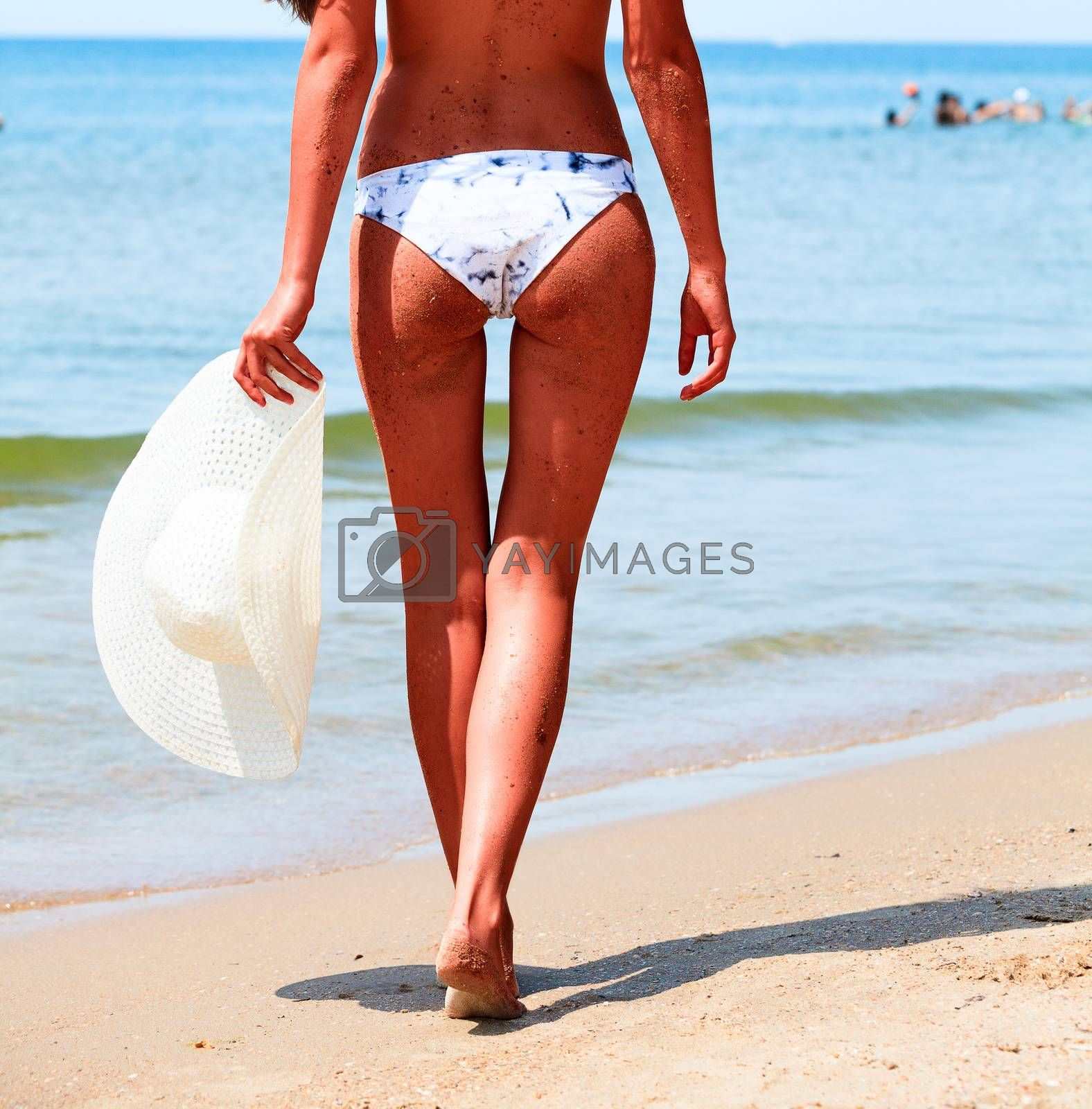Sexy tanned woman on a sea beach