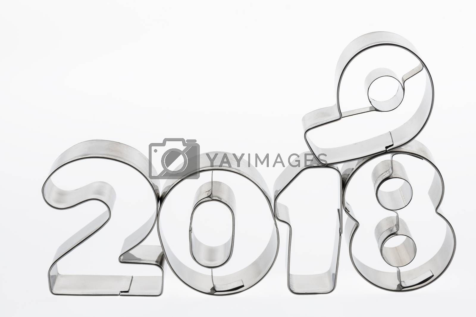 Text two thousand eighteen and nineteen in metal put figures on a white background as a visualization of the coming new year