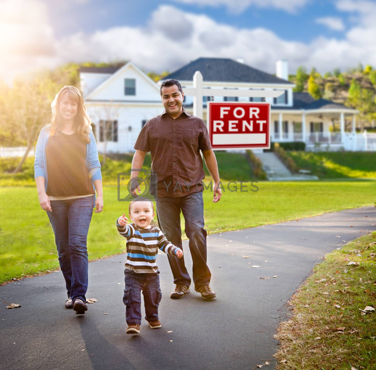 Happy Mixed Race Family Walking in Front of Home and For Rent Real Estate Sign.