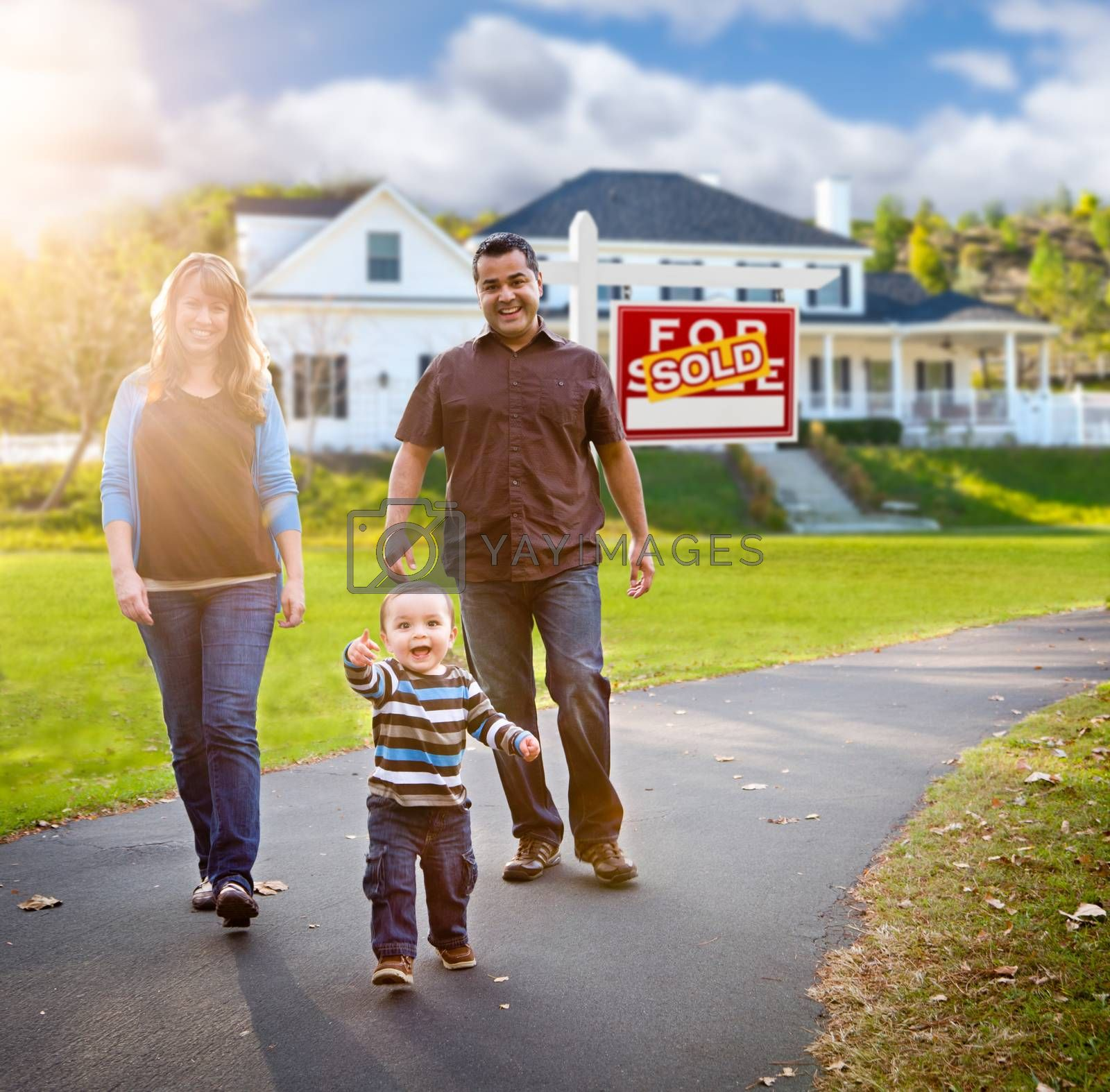 Happy Mixed Race Family Walking In Front Of Home And Sold For Sale Real Estate Sign