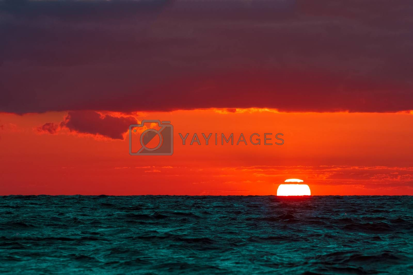 Hot and romantic sunset over the Baltic sea. Calm landscape