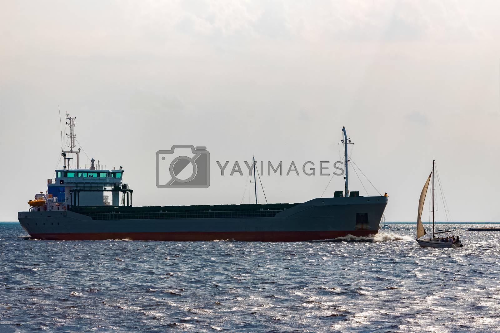 Grey bulker ship. Logistics and merchandise transportations