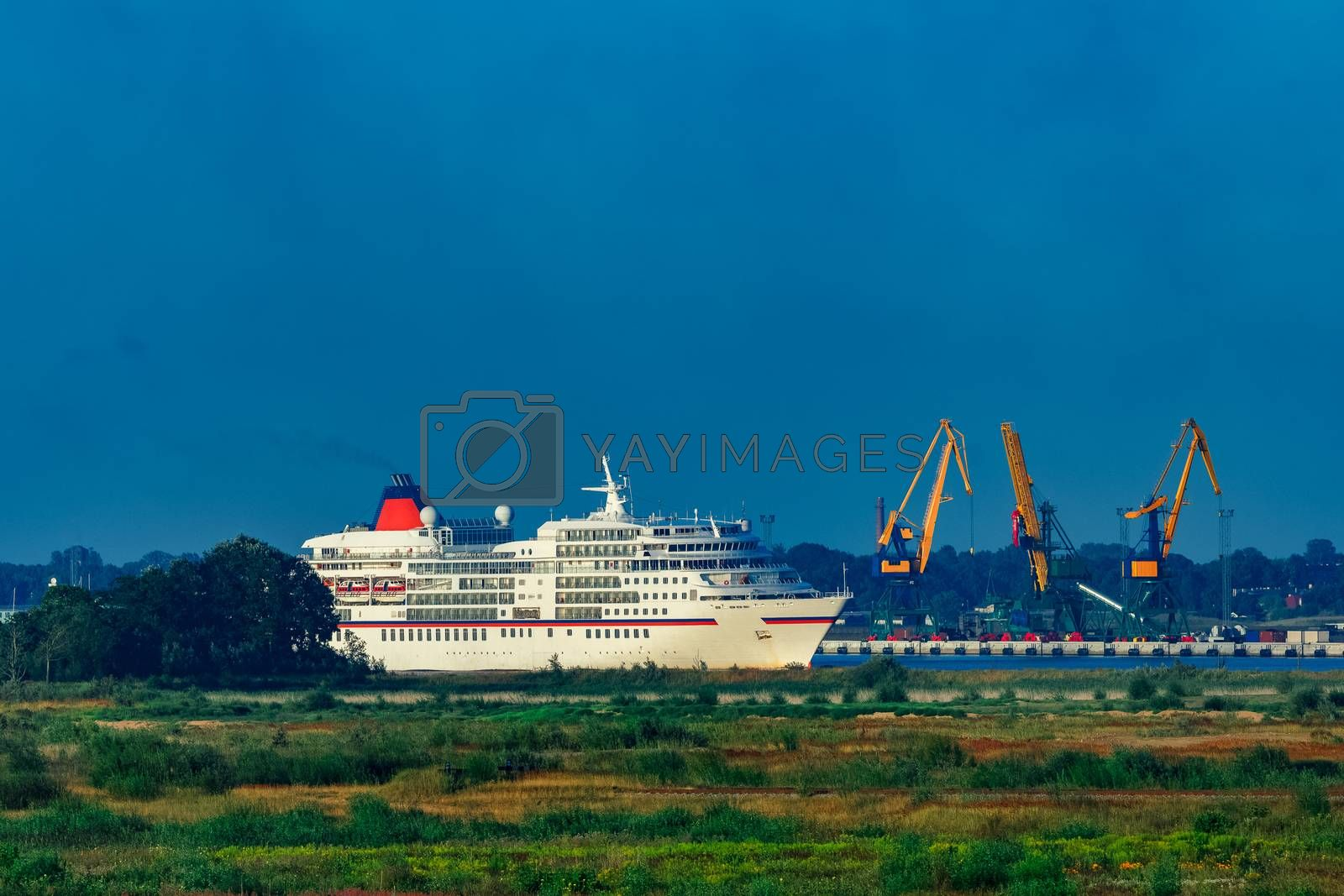 White cruise liner in Riga city. Tour travel and spa services