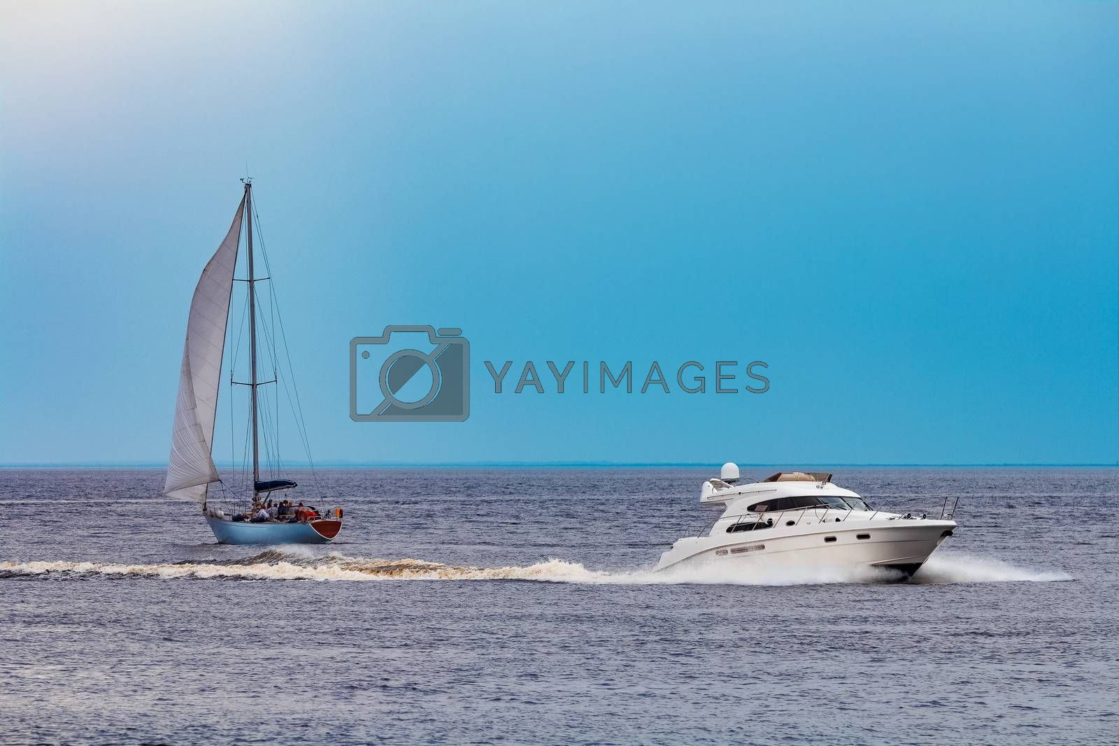 White speed boat moving fast to the Baltic sea. Water sport