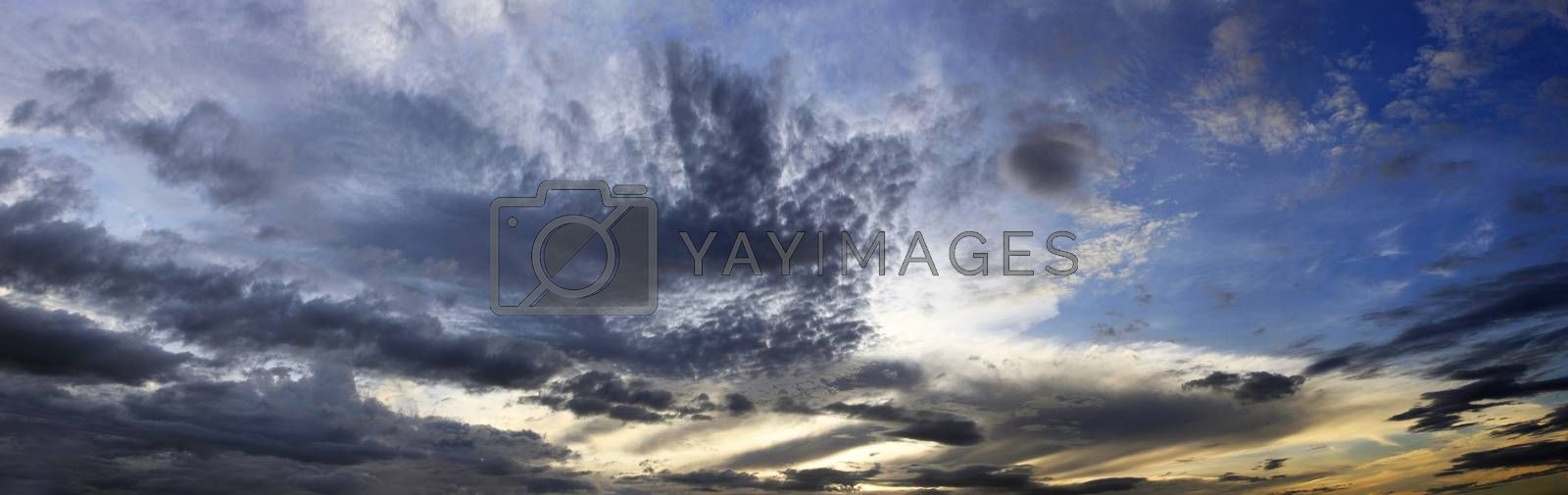 The image of clouds on a background of the dark blue sky