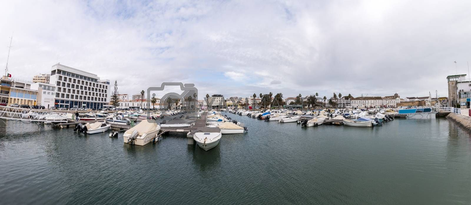 Wide view of Faro city docks with fishing and recreational boats.