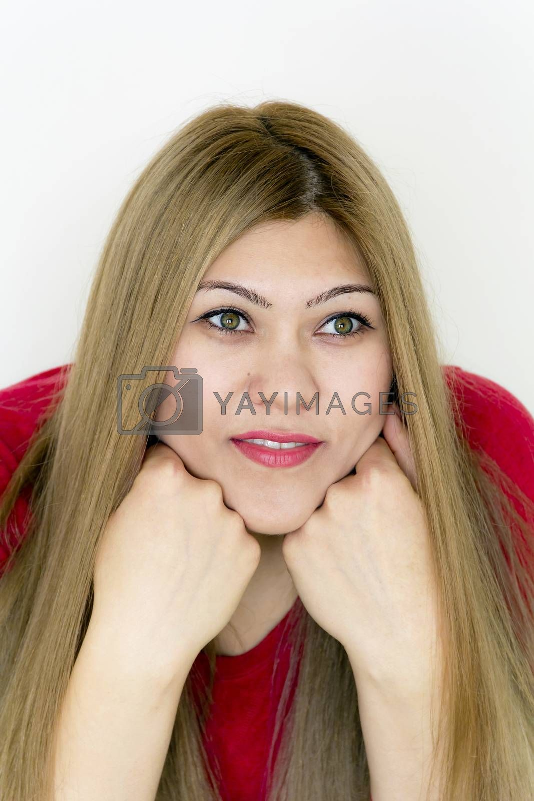 Attractive young girl with long brown healthy straight hair