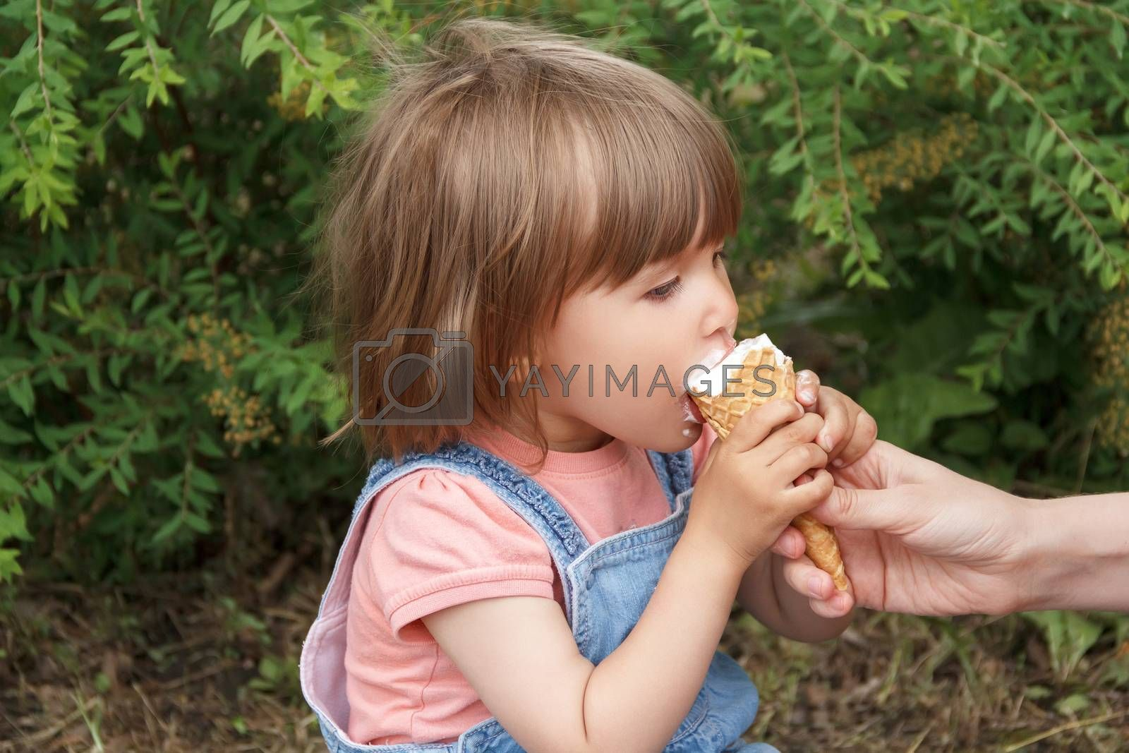Photo of cute girl are eating icecream in summer
