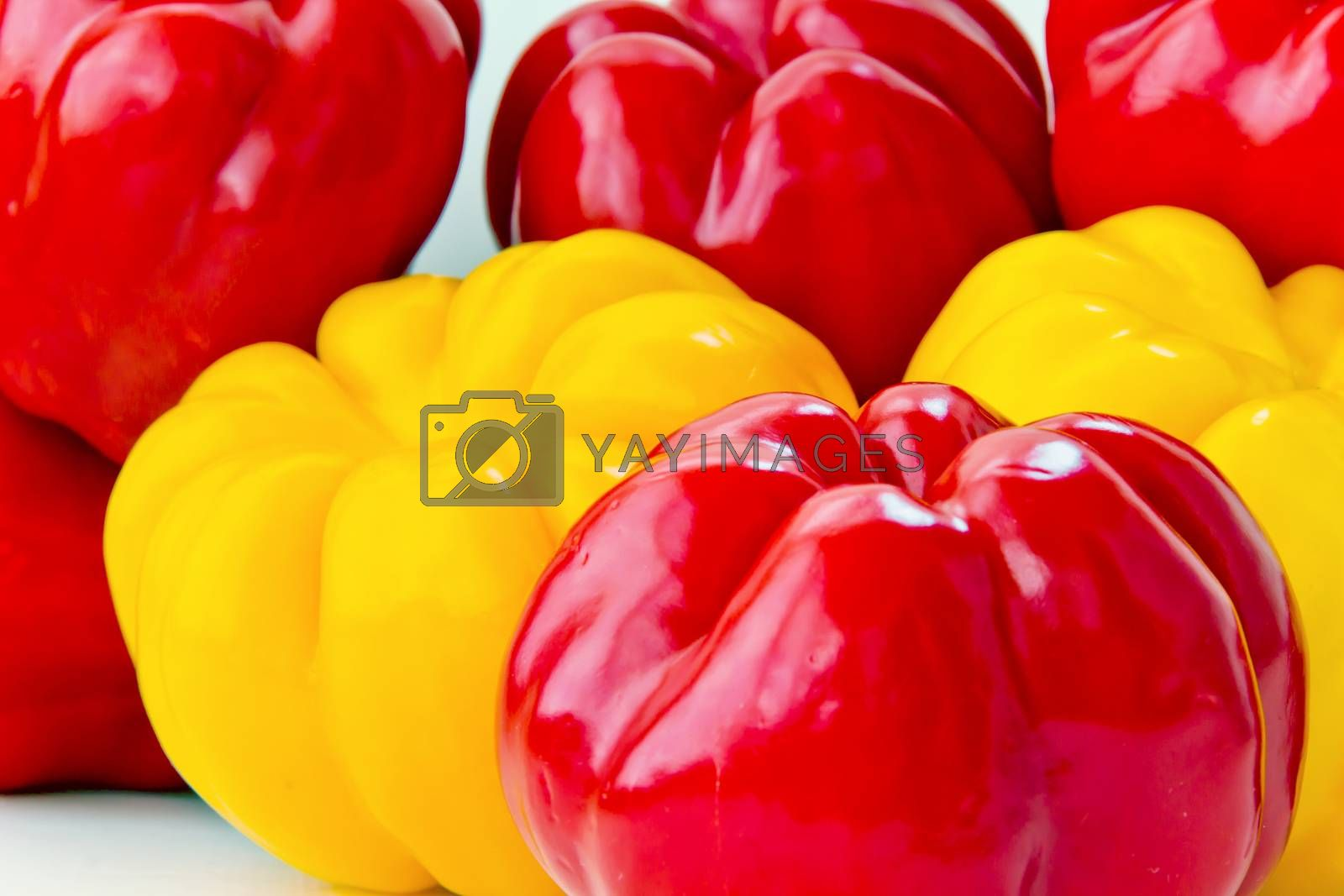 Background of big fresh red and yellow raw pepper