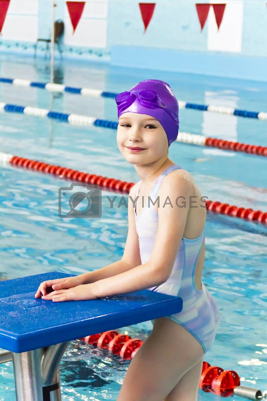 Portrait of smiling cute girl in swimming pool