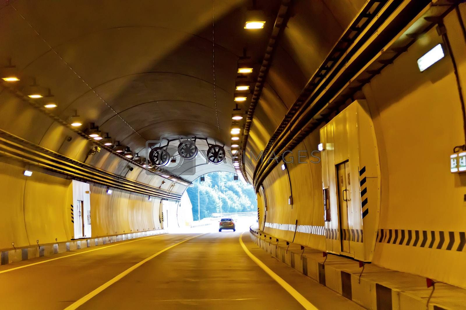 Driving in a tunnel with sunlight in the end