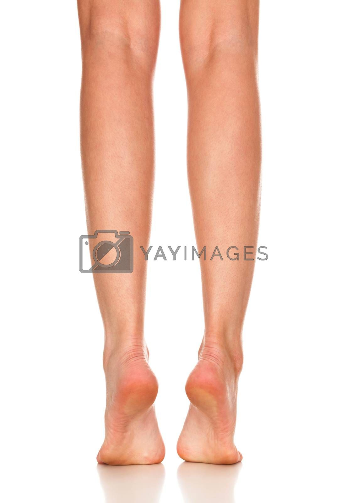Closeup shot of female bare feet, isolated on white background