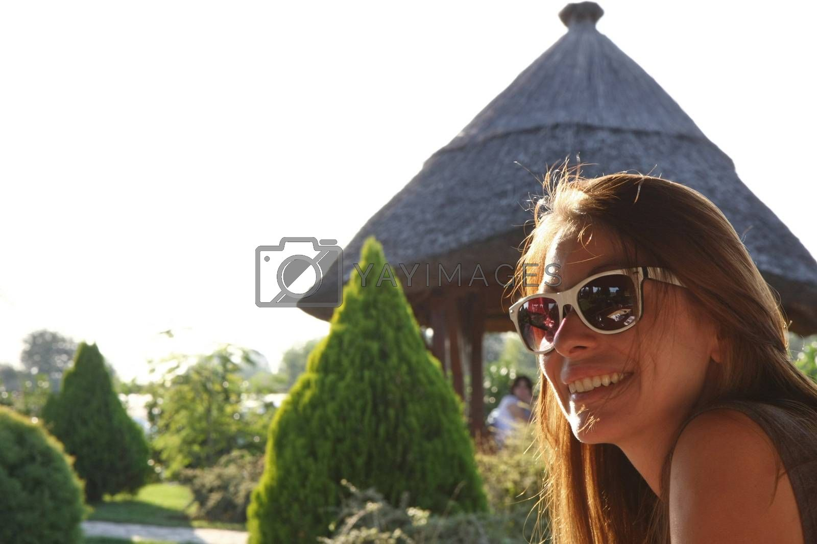 Portrait of young woman wth glasses  relaxing in nature