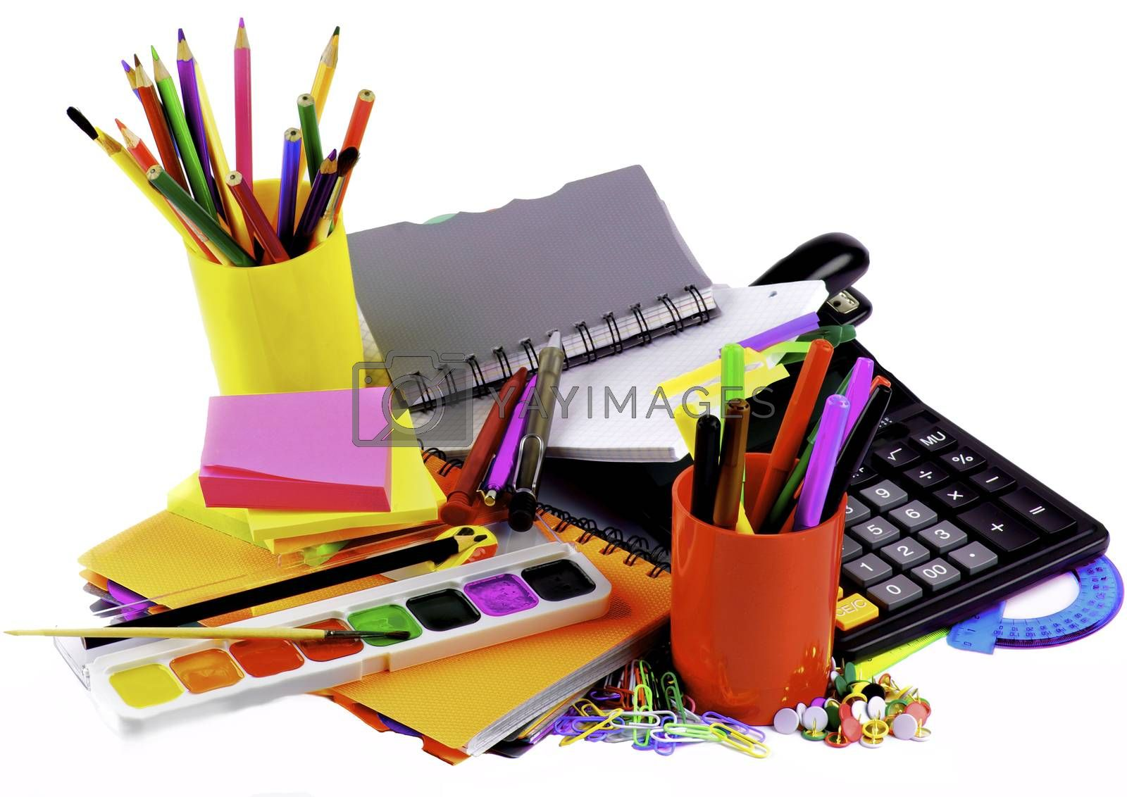 School Supplies Concept with Various Colorful Ballpoint Pens, Pencils, Felt Tip Pens, Pencil Sharpener, Watercolor Paints, Paper Clips, Calculator and Sticky Notes closeup on White background