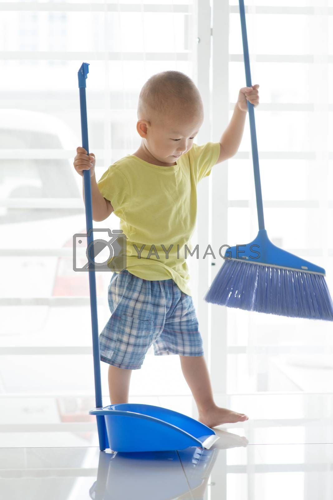 Toddler sweeping floor by szefei