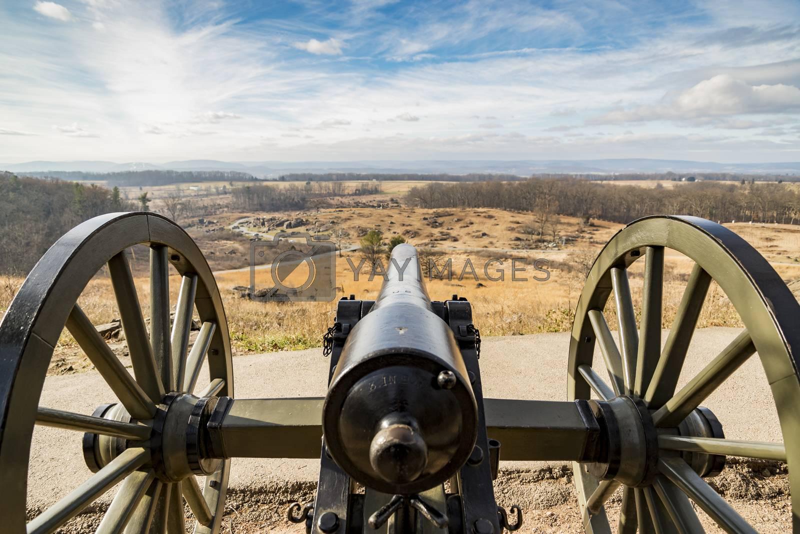 Civil war canon behind a stone wall on the Gettysburg battlefield in Autumn near sunset