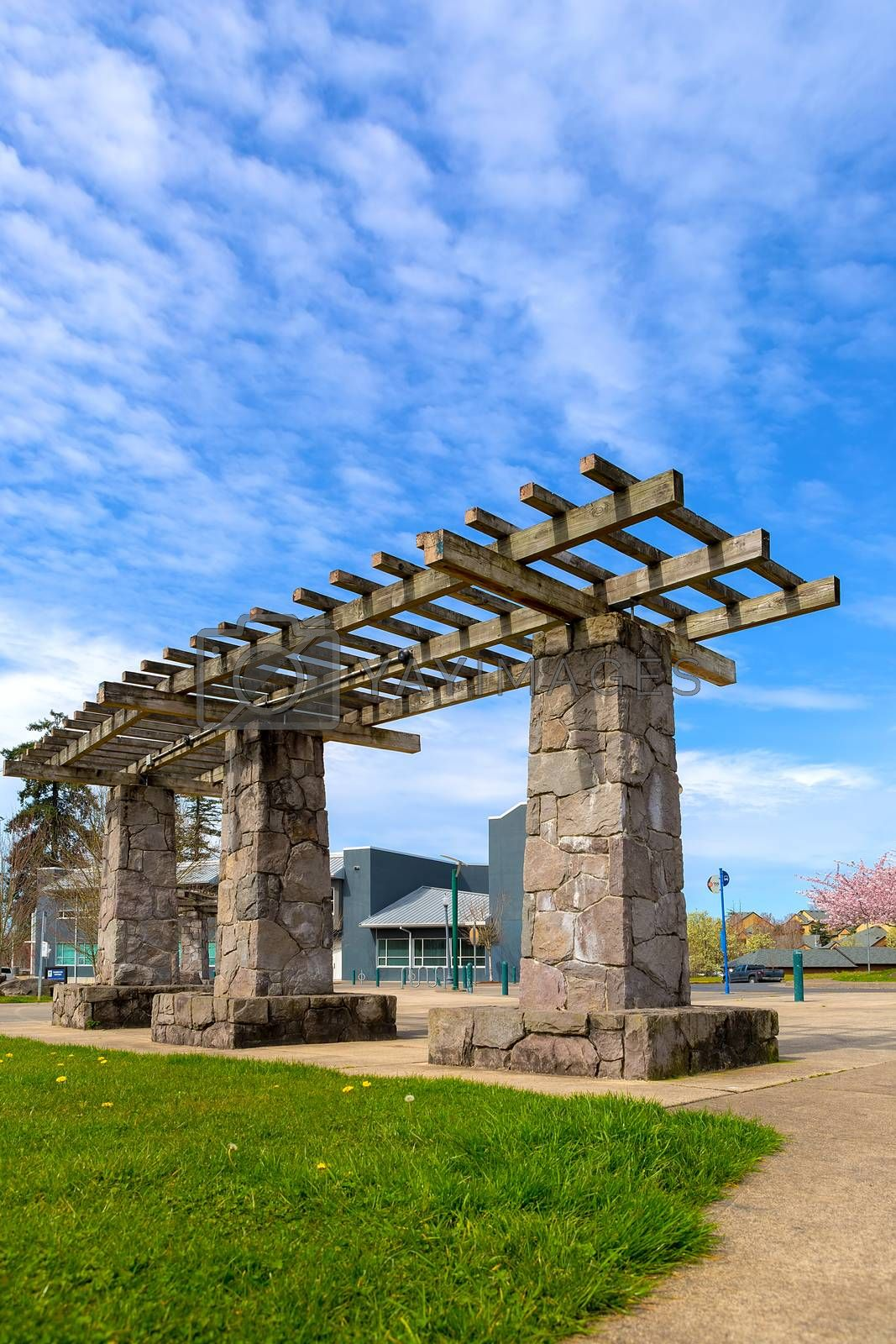 Wood and Stone Pergola structure in Happy Valley Green Village city park by the library in spring season