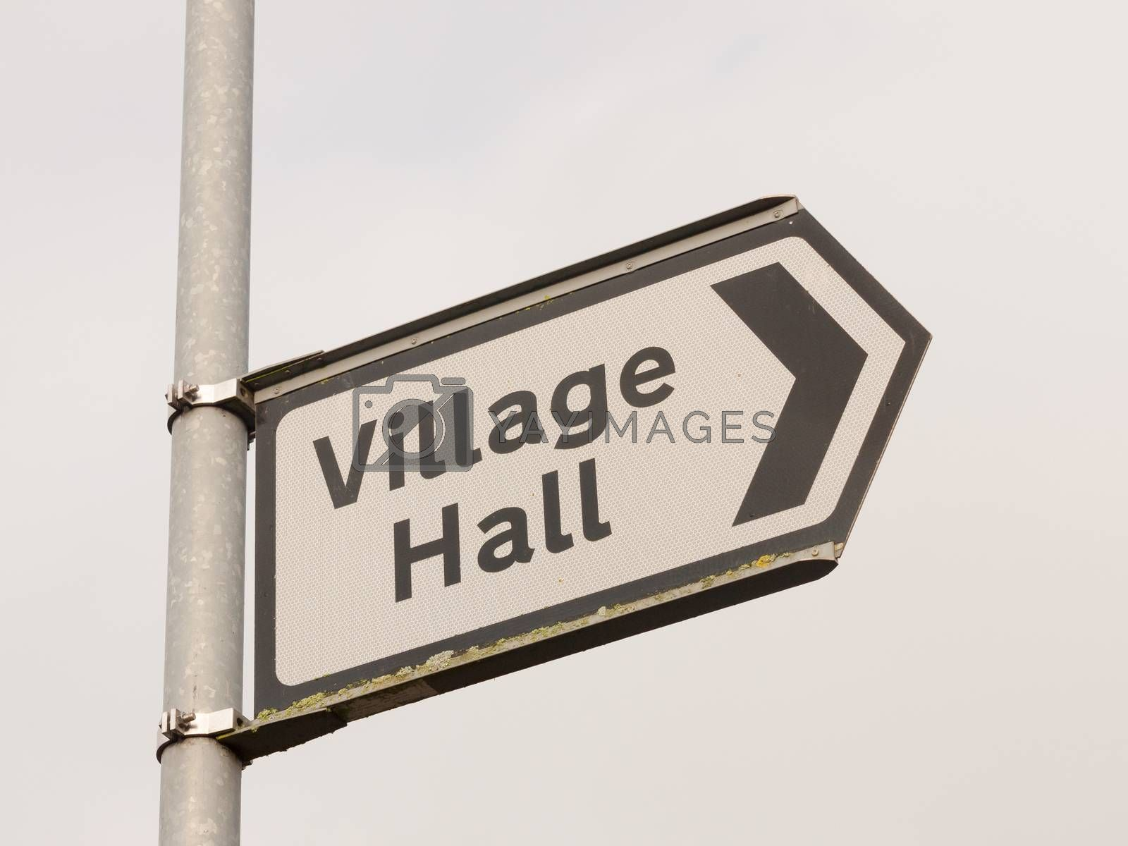 white and black village hall sign post direction street; essex; england; uk