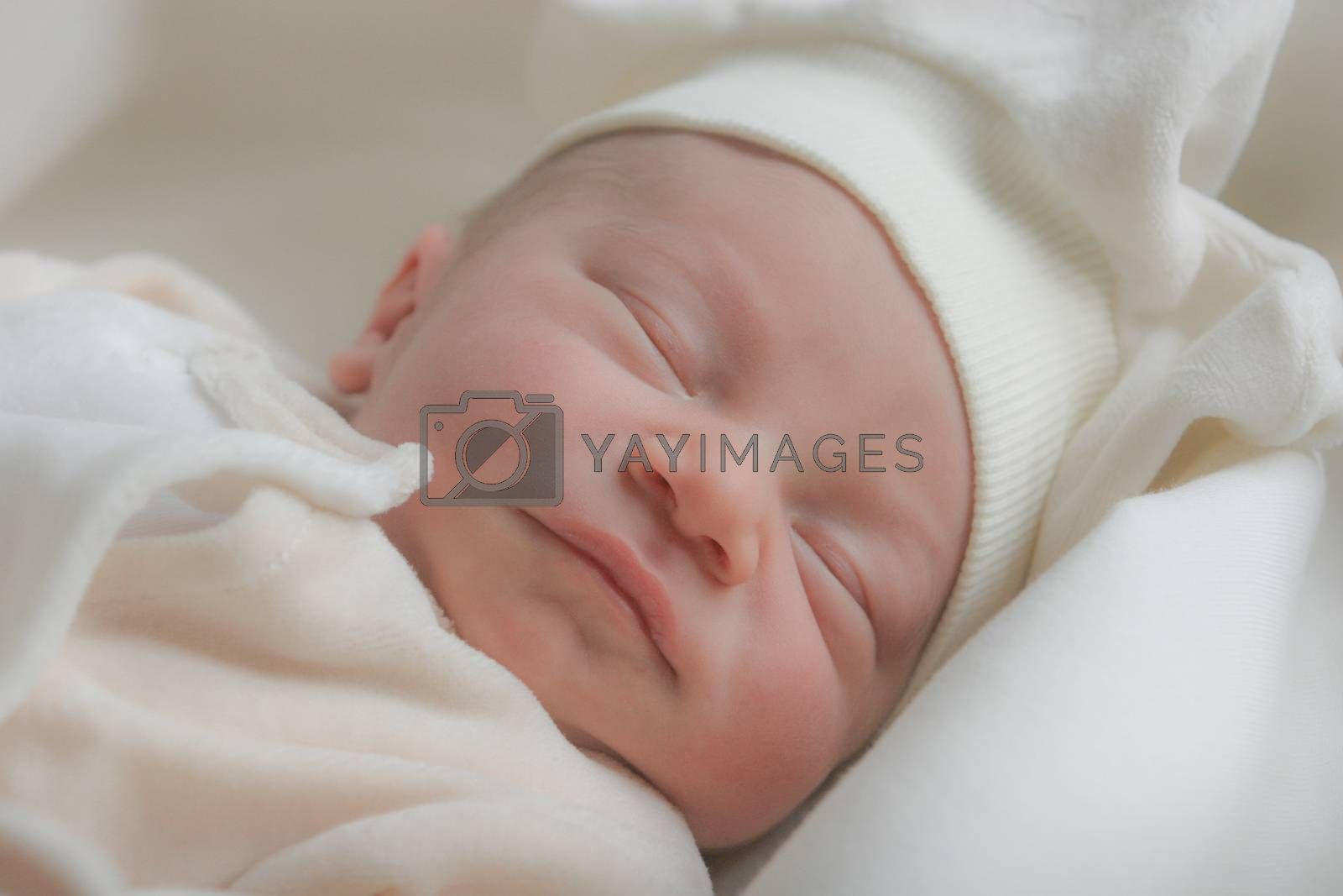 Cute sleeping baby, dressed with soft cotton clothes.
