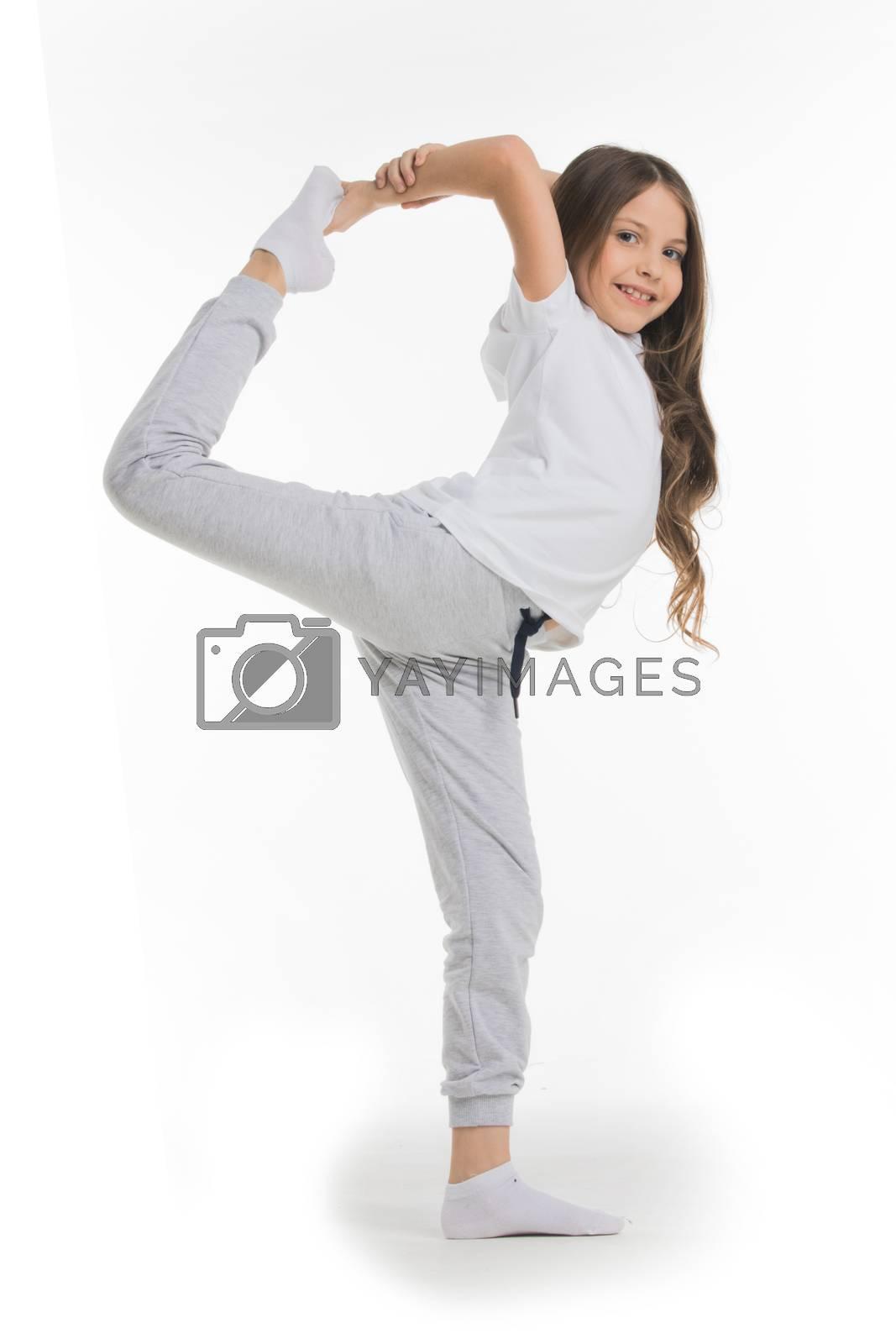 Yoga pose, girl standing stretching legs, leg split isolated on white background