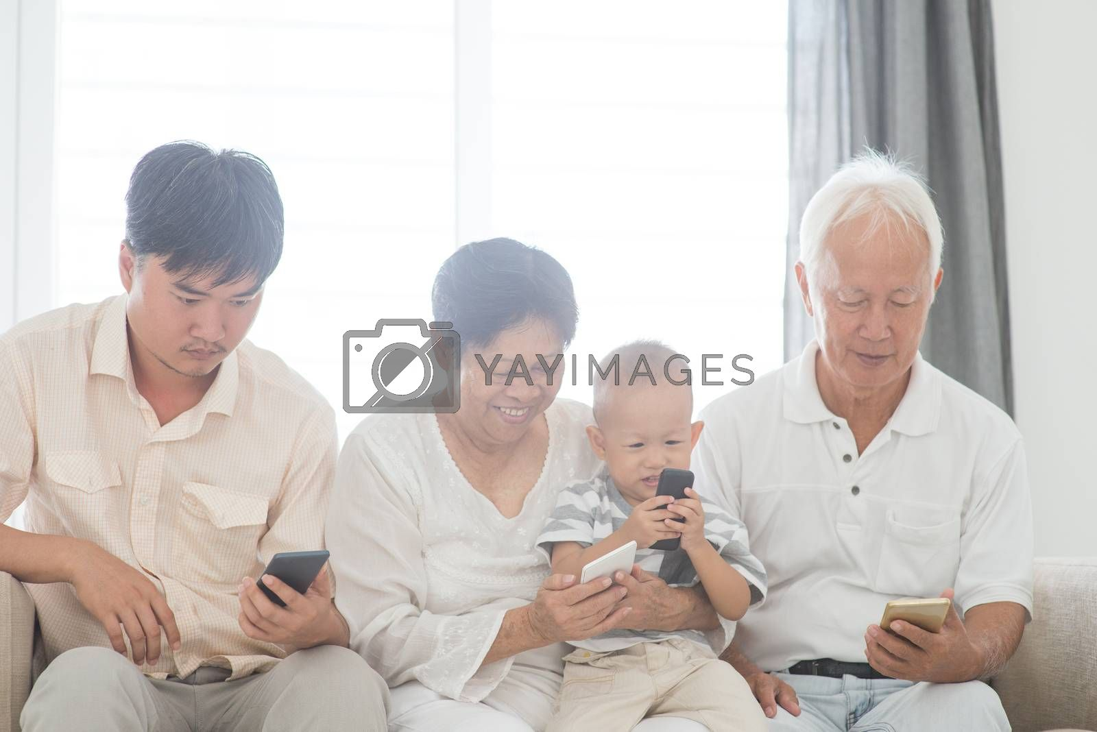 Technology, gadgets addicted family. Member family busy with their smart phone, communication problem.