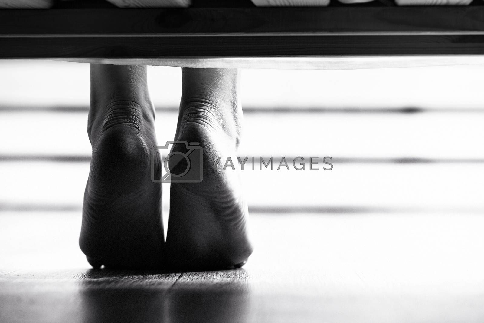Closeup shot of dangling female bare feet by Nobilior