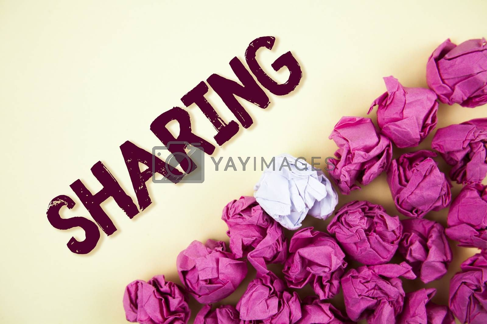 Text sign showing Sharing. Conceptual photo To Share Give a portion of something to another Possess in common written Plain background Crumpled Paper Balls next to it.
