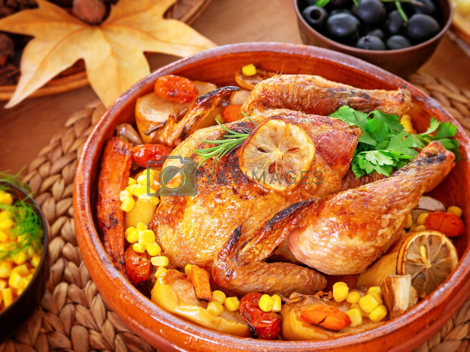 Beautiful festive food still life, tasty crispy chicken with baked vegetables on the centerpiece of table, traditional family dinner in Thanksgiving day