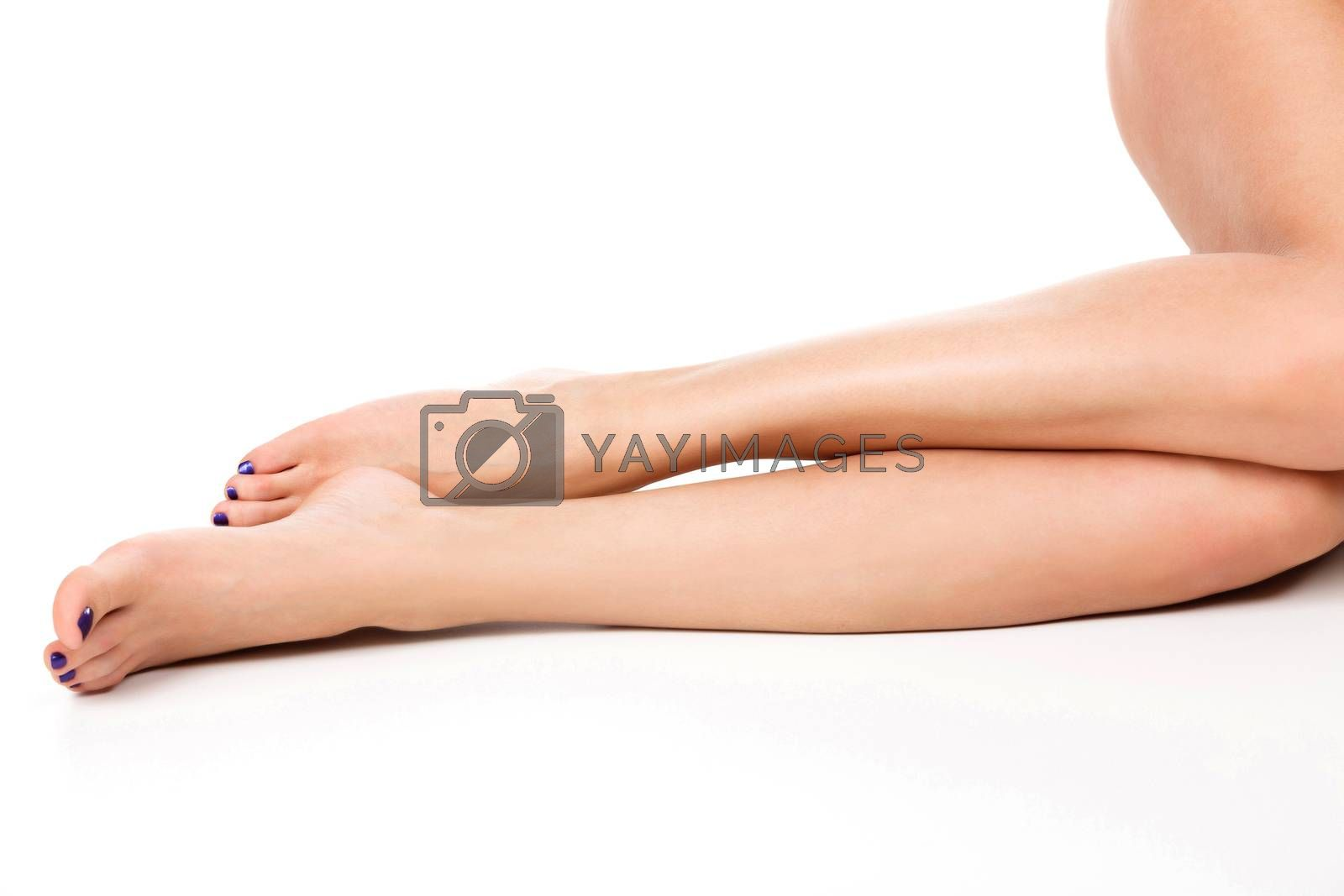 Beautiful female legs with clean smooth skin, isolated on white background