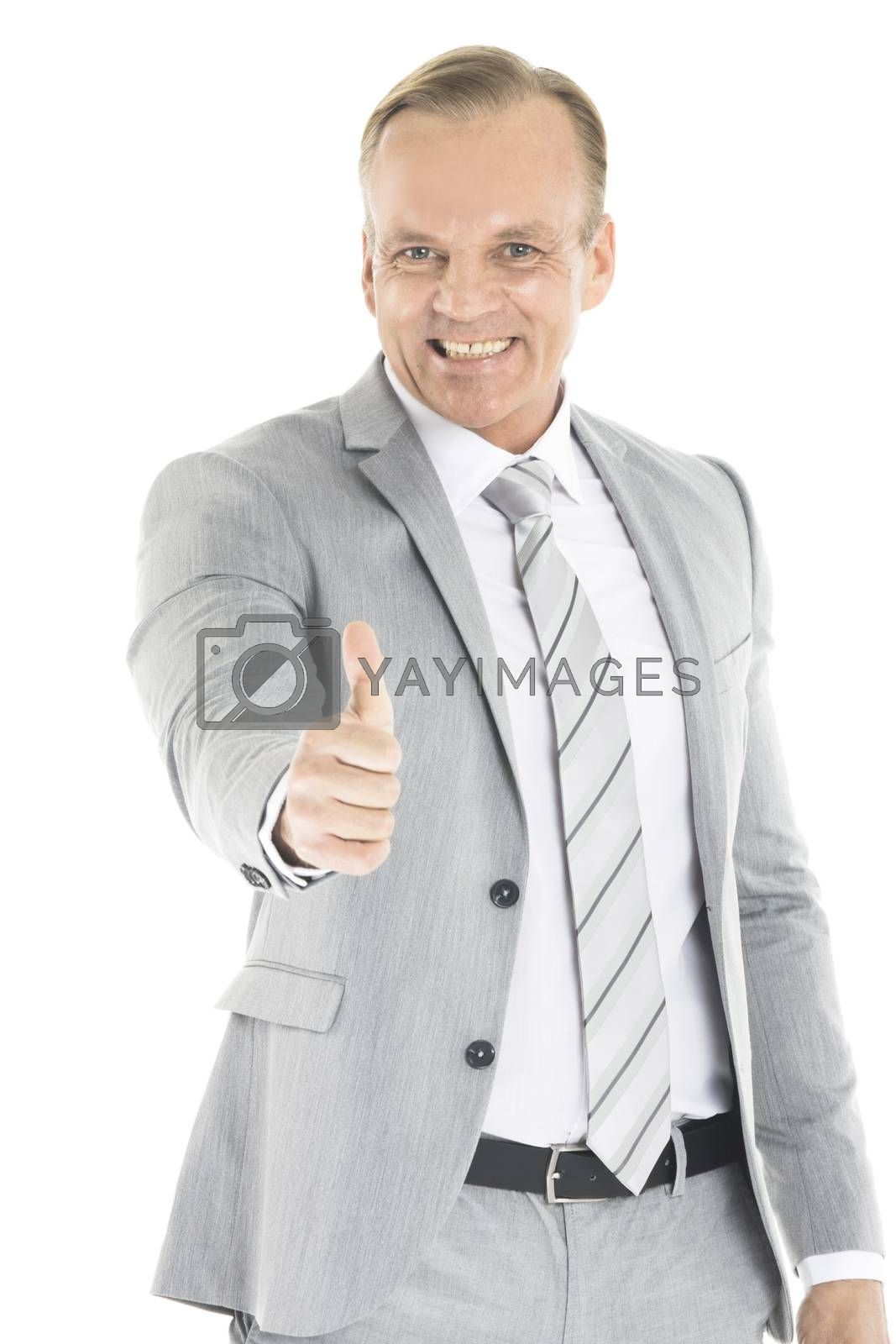 Mature business man showing thumb up gesture, isolated on white background