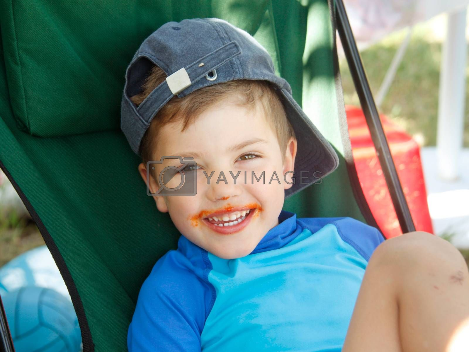 Royalty free image of Little Boy Smile Dirty Mouth by vilevi