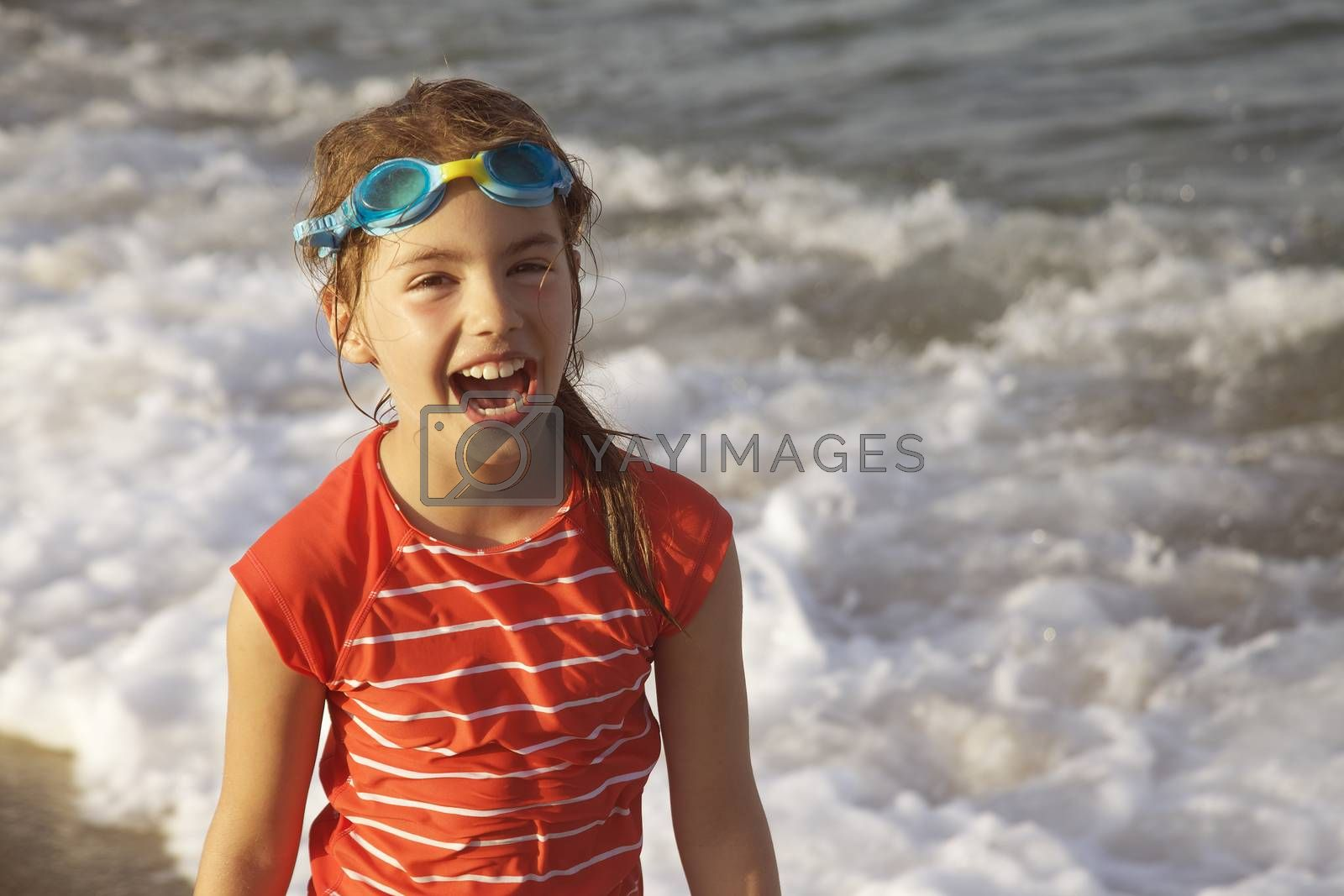 Royalty free image of Girl Laughing Sea by vilevi
